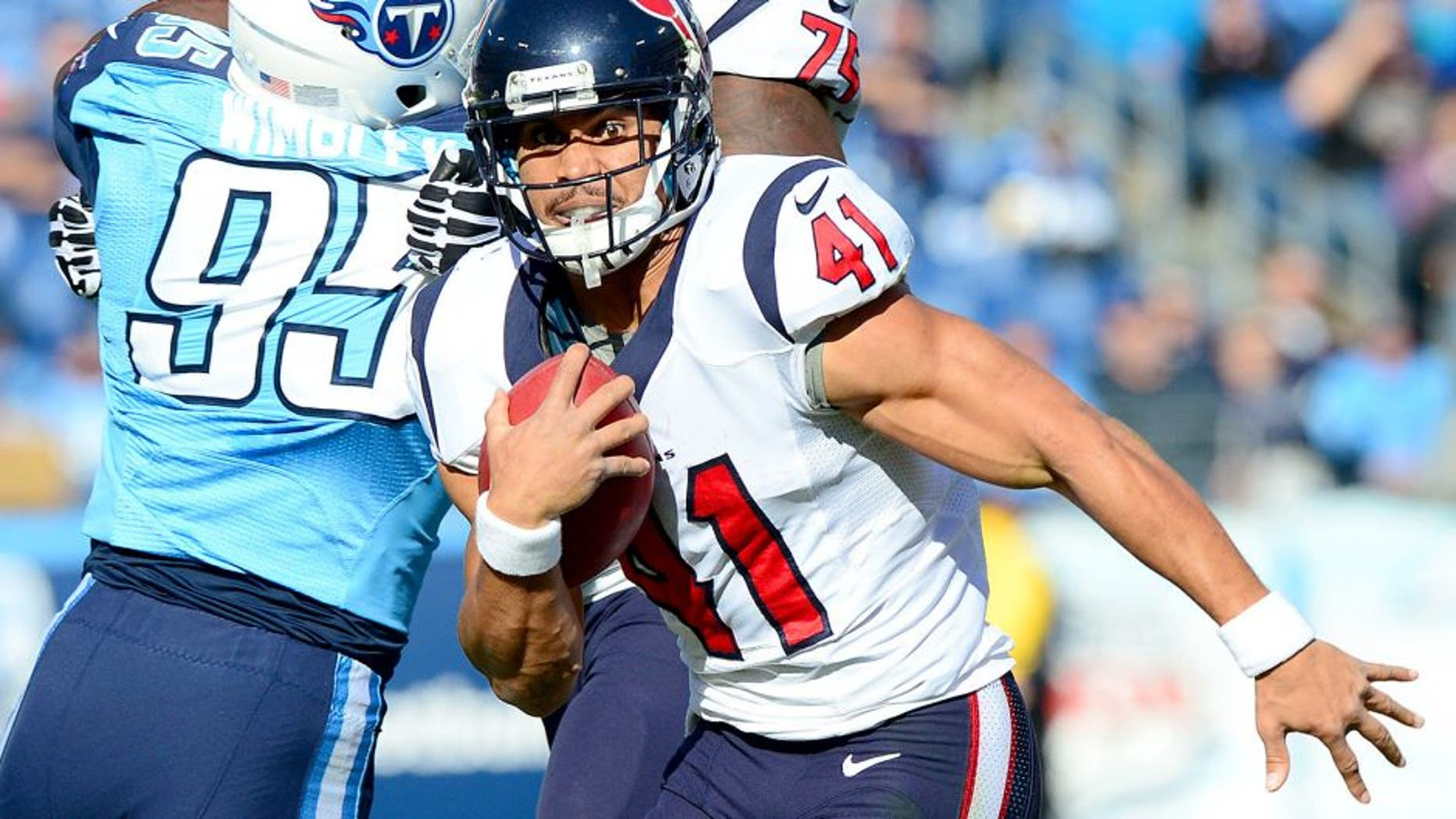 Dec 29, 2013; Nashville, TN, USA; Houston Texans running back Jonathan Grimes (41) carries the ball against the Tennessee Titans during the first half at LP Field. The Titans won 16-10. Mandatory Credit: Don McPeak-USA TODAY Sports