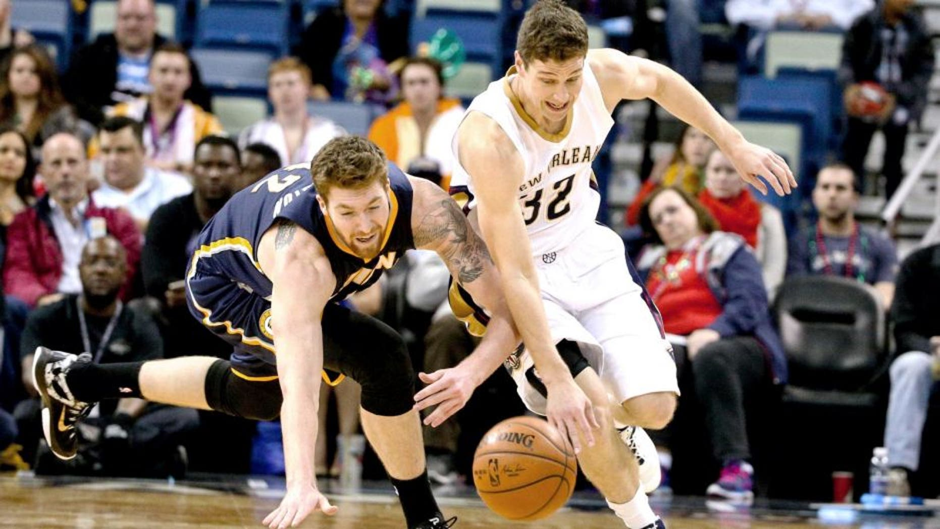 Feb 11, 2015; New Orleans, LA, USA; New Orleans Pelicans guard Jimmer Fredette (32) and Indiana Pacers forward Shayne Whittington (42) scramble for a loose ball during the second half of a game at the Smoothie King Center. The Pacers defeated the Pelicans 106-93.Mandatory Credit: Derick E. Hingle-USA TODAY Sports