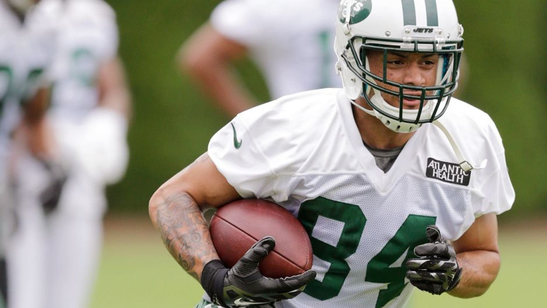 New York Jets wide receiver Devin Smith (84) runs after making a catch at NFL football training camp, Thursday, July 30, 2015, in Florham Park, N.J. (AP Photo/Frank Franklin II)