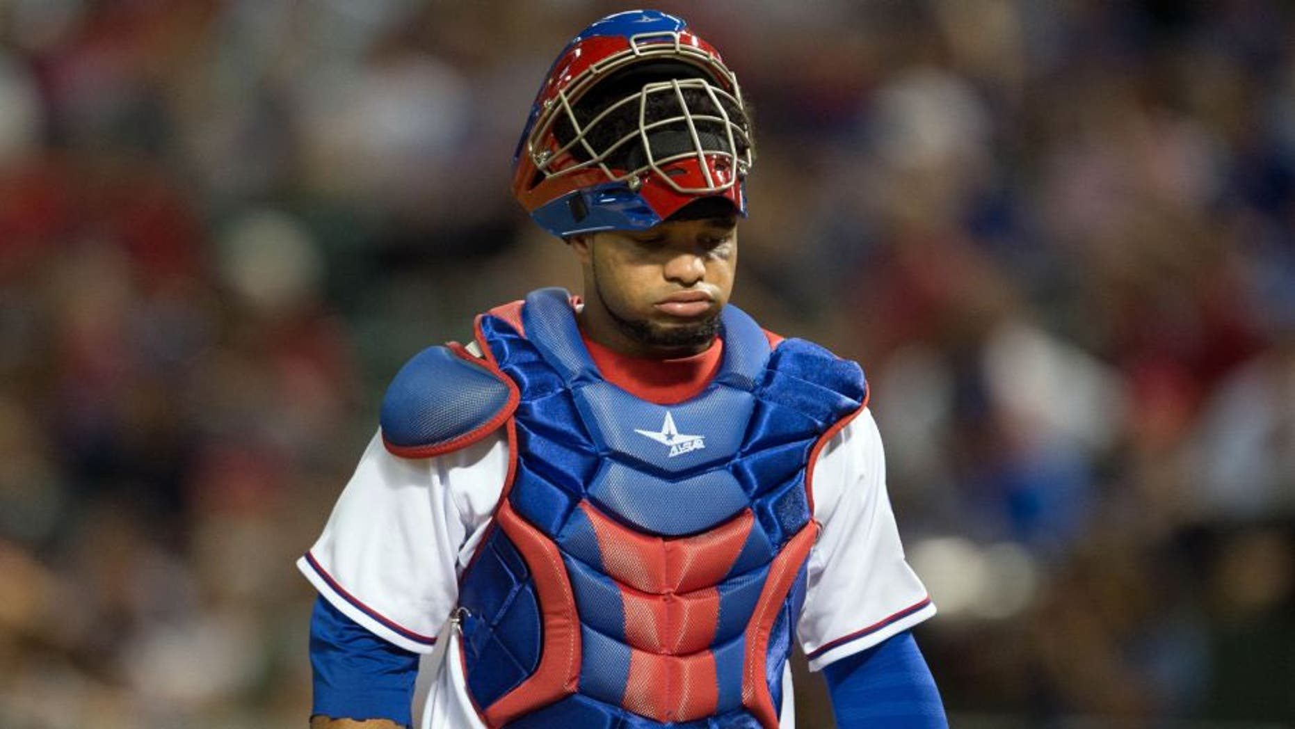 Sep 10, 2014; Arlington, TX, USA; Texas Rangers catcher Tomas Telis (6) reacts to an error by his team during the game against the Los Angeles Angels at Globe Life Park in Arlington. The Angels defeated the Rangers 8-1. Mandatory Credit: Jerome Miron-USA TODAY Sports