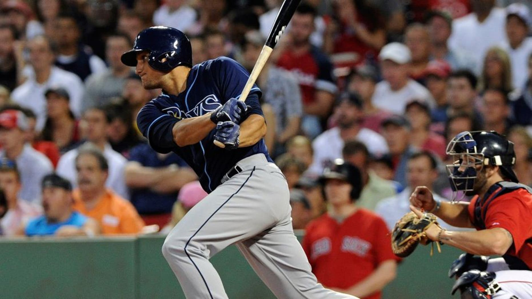Jul 31, 2015; Boston, MA, USA; Tampa Bay Rays left fielder Mikie Mahtook (27) hits an RBI single during the third inning against the Boston Red Sox at Fenway Park. Mandatory Credit: Bob DeChiara-USA TODAY Sports