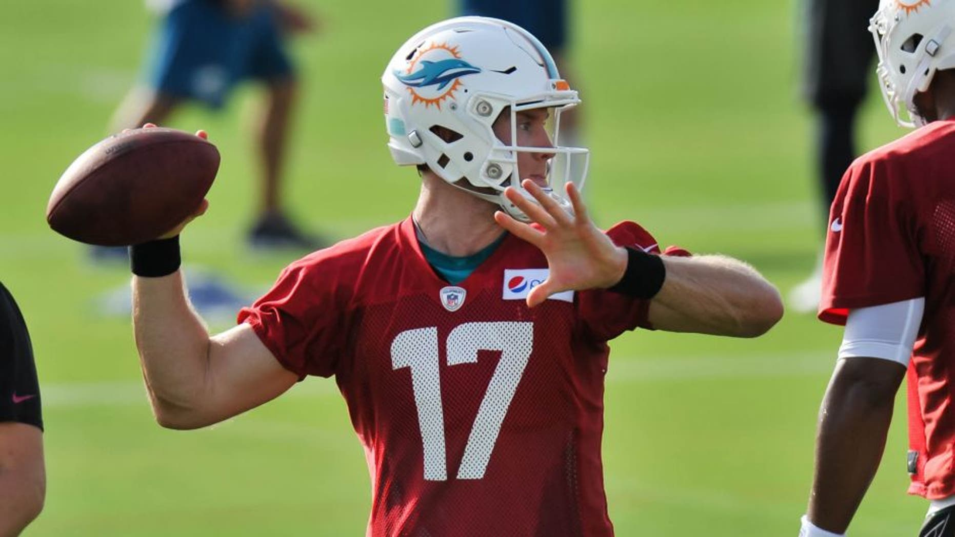 Jul 31, 2015; Davie, FL, USA; Miami Dolphins quarterback Ryan Tannehill (17) during practice drills at Doctors Hospital Training Facility. Mandatory Credit: Steve Mitchell-USA TODAY Sports