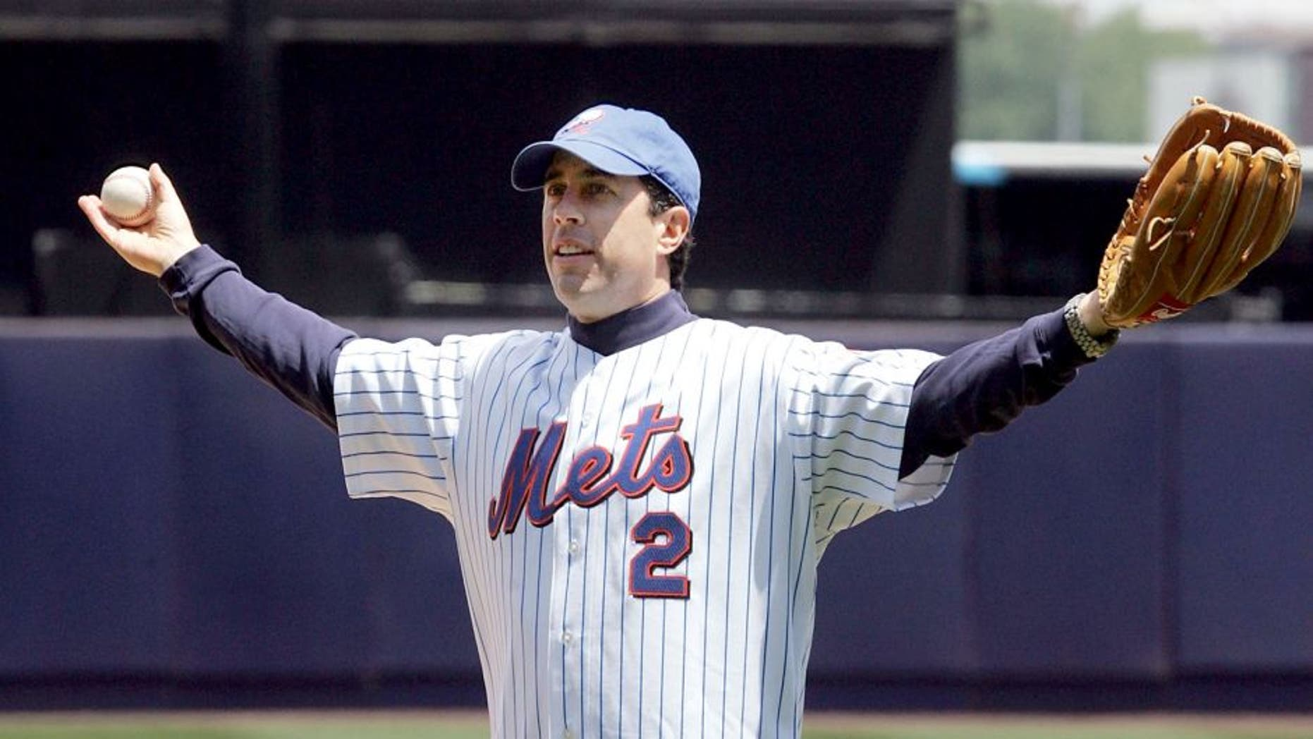 FLUSHING, NY - MAY 22: Comedian Jerry Seinfeld is introduced before throwing out the first pitch of the New York Mets vs New York Yankees game at Shea Stadium on May 22, 2005 in Flushing, New York. The Yankees defeated the Mets 5-3. (Photo by Jim McIsaac/Getty Images)
