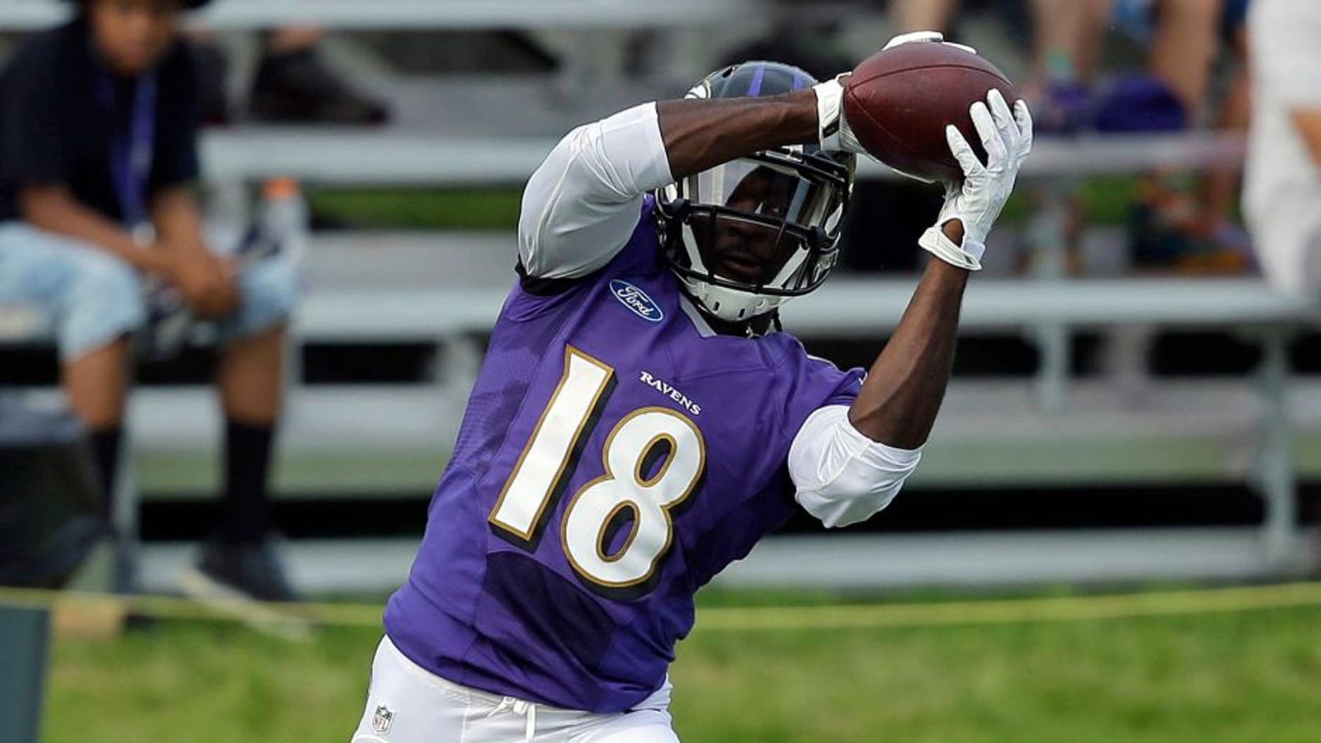 Baltimore Ravens wide receiver Breshad Perriman makes a catch in front of spectators at the team's first day of NFL football training camp, Thursday, July 30, 2015, in Owings Mills, Md. (AP Photo/Patrick Semansky)
