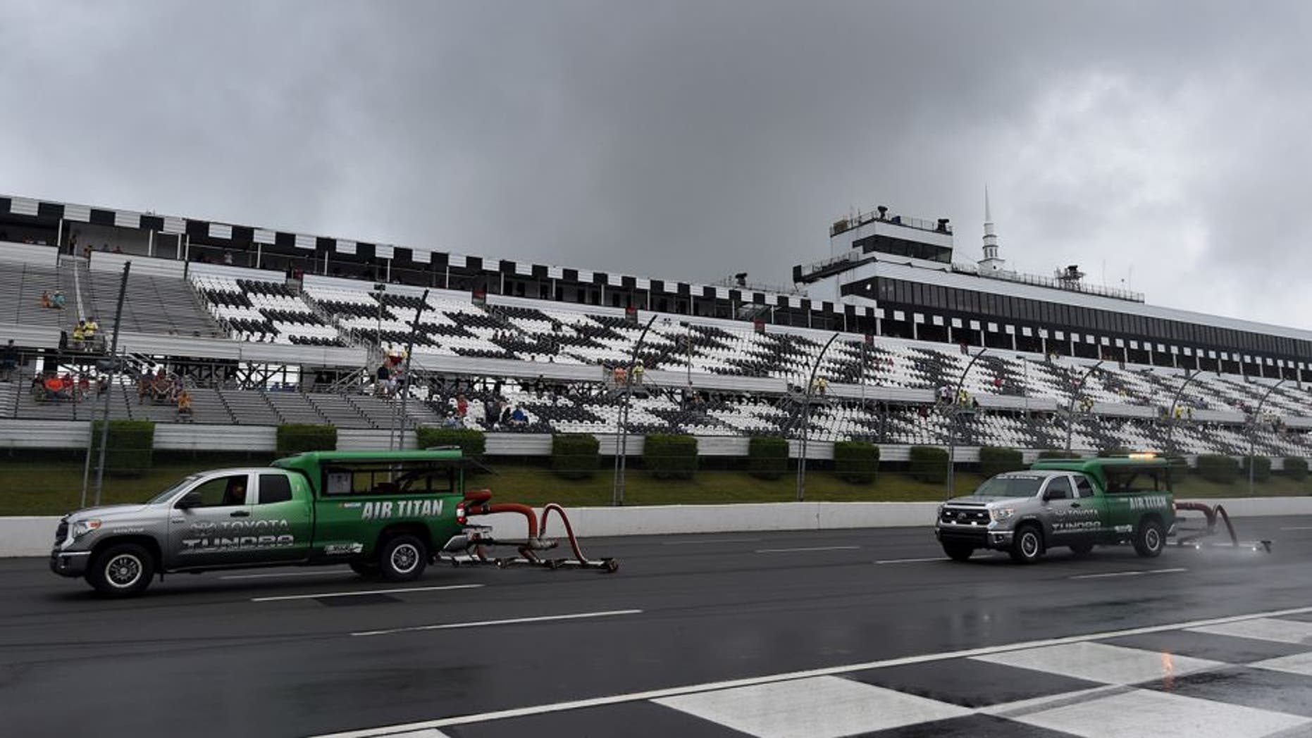 LONG POND, PA - JULY 31: Air Titan's dry the track during rainy weather prior to the NASCAR Sprint Cup Series Pennsylvania 400 at Pocono Raceway on July 31, 2016 in Long Pond, Pennsylvania. (Photo by Rainier Ehrhardt/NASCAR via Getty Images)