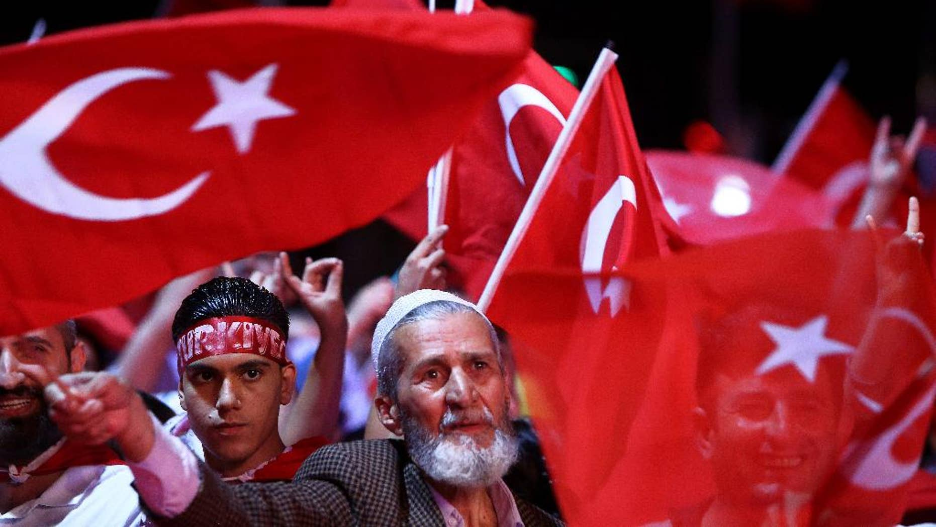 July 26, 2016: People wave Turkish flags as they take part in an anti coup rally at Taksim square in Istanbul.