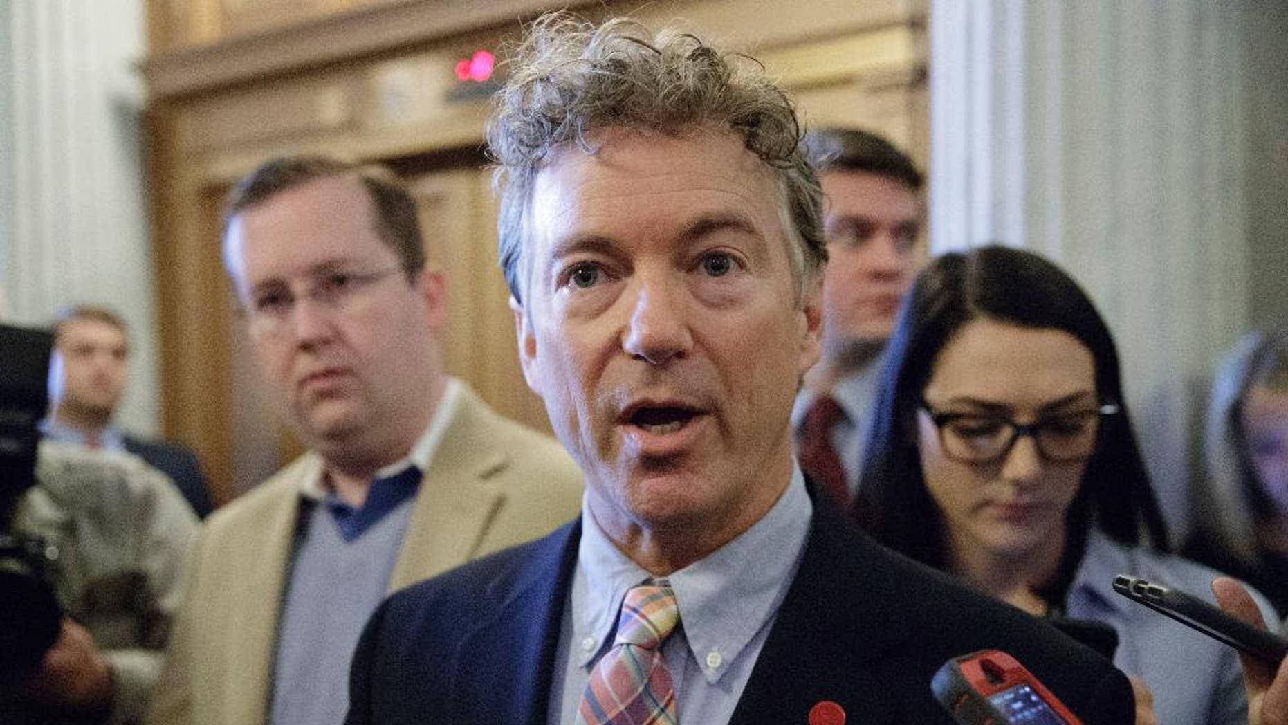 FILE - In this April 7, 2017, file photo, Sen. Rand Paul, R-Ky., speaks to reporters on Capitol Hill in Washington. Paul and Sen. Ron Wyden, D-Ore., are asking the nation's top intelligence official to release more information about the communications of American citizens swept up in surveillance operations. (AP Photo/J. Scott Applewhite, file)