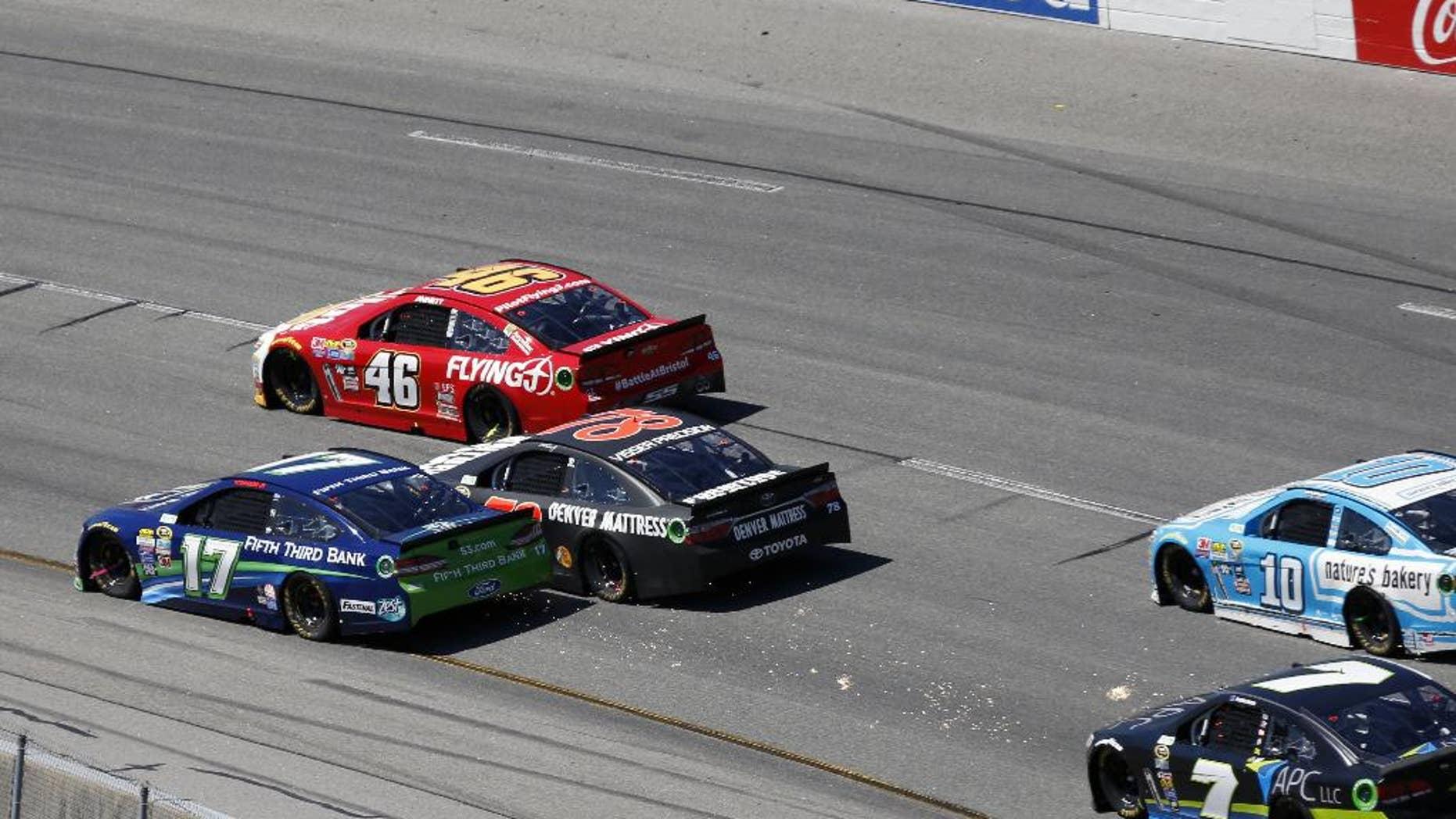 Ricky Stenhouse Jr. and Martin Truex Jr. make contact during the Sprint Cup auto race at Richmond International Raceway in Richmond, Va., Sunday, April 24, 2016. (AP Photo/Chet Strange)