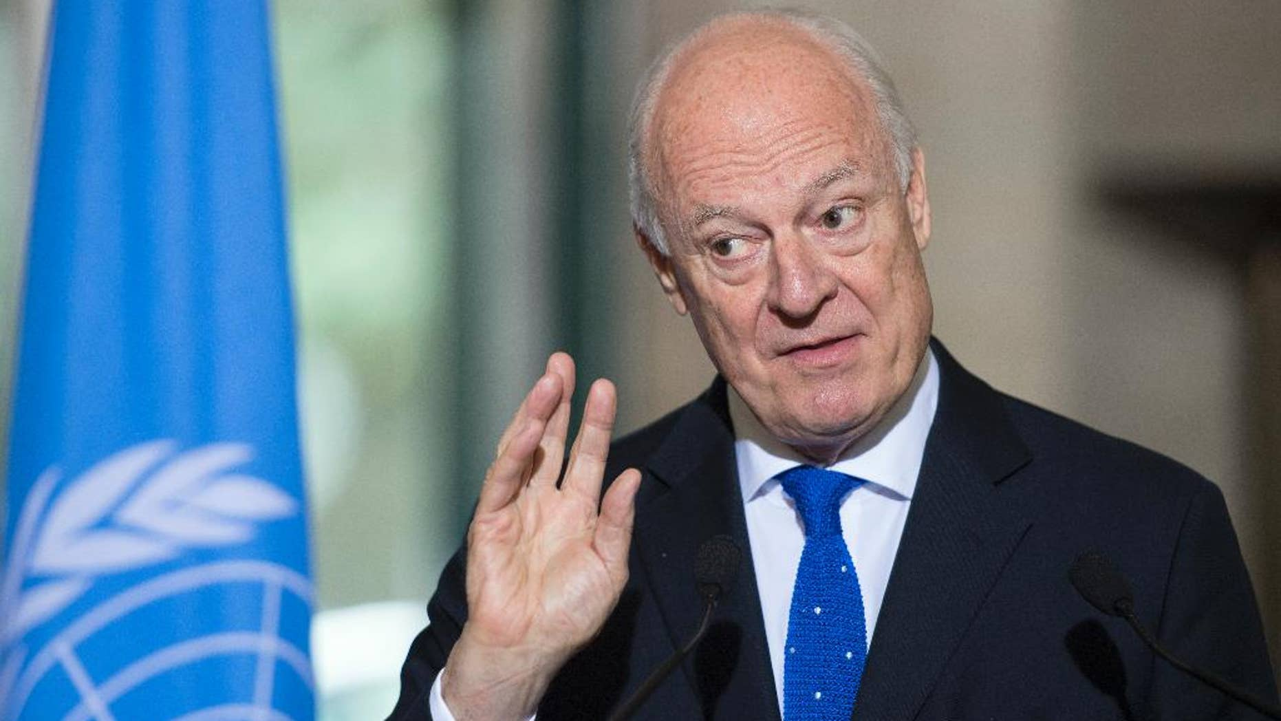 """Staffan de Mistura, UN Special Envoy for Syria, speaks during a news conference at the European headquarters of the United Nations, in Geneva, Switzerland, Thursday, May 19, 2016. De Mistura says he's waiting to see """"gestures"""" following a Vienna meeting on Syria of world and regional powers earlier this week, before setting a target date for the indirect talks between President Bashar Assad's envoys and opposition groups to resume in Geneva. (Martial Trezzini/Keystone via AP)"""