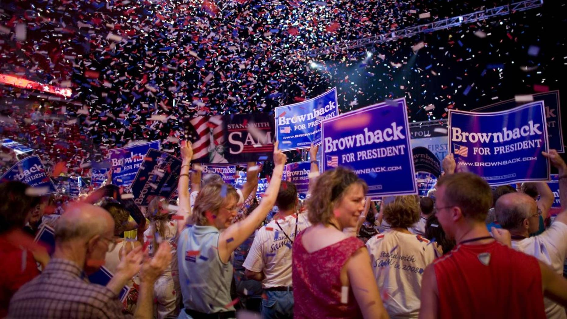 FILE -- Supporters of presidential hopeful U.S. Sen. Sam Brownback, R-Kan., cheer as confetti falls after Brownback finished speaking at the Iowa Straw Poll in Ames, Iowa, Saturday, Aug 11, 2007. (AP File Photo/David Lienemann)