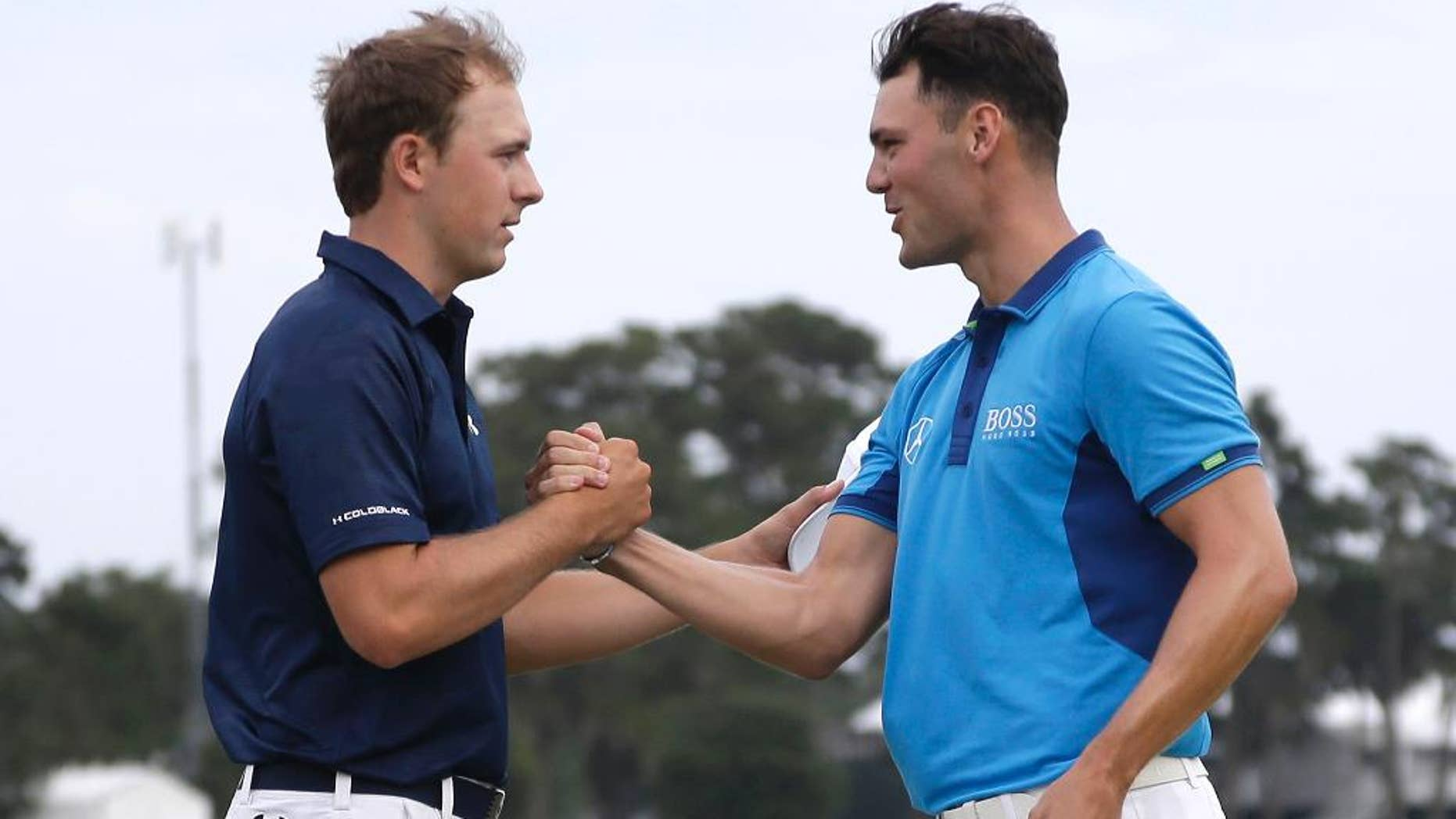 Jordan Spieth, left, and Martin Kaymer of Germany, shake hands at the end of the third round of The Players championship golf tournament at TPC Sawgrass, Saturday, May 10, 2014 in Ponte Vedra Beach, Fla. (AP Photo/Lynne Sladky)