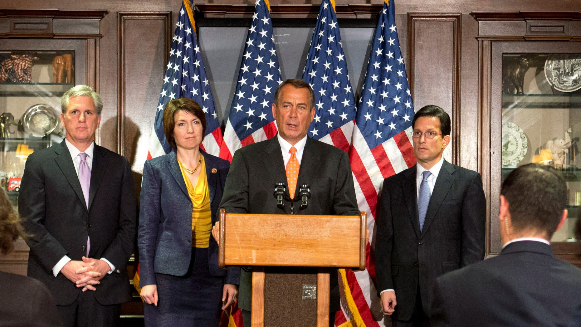 FILE: April 16, 2013: House Speaker John Boehner,center, accompanied by members of the House Republican leadership, speaks on Capitol Hill, in Washington, D.C.