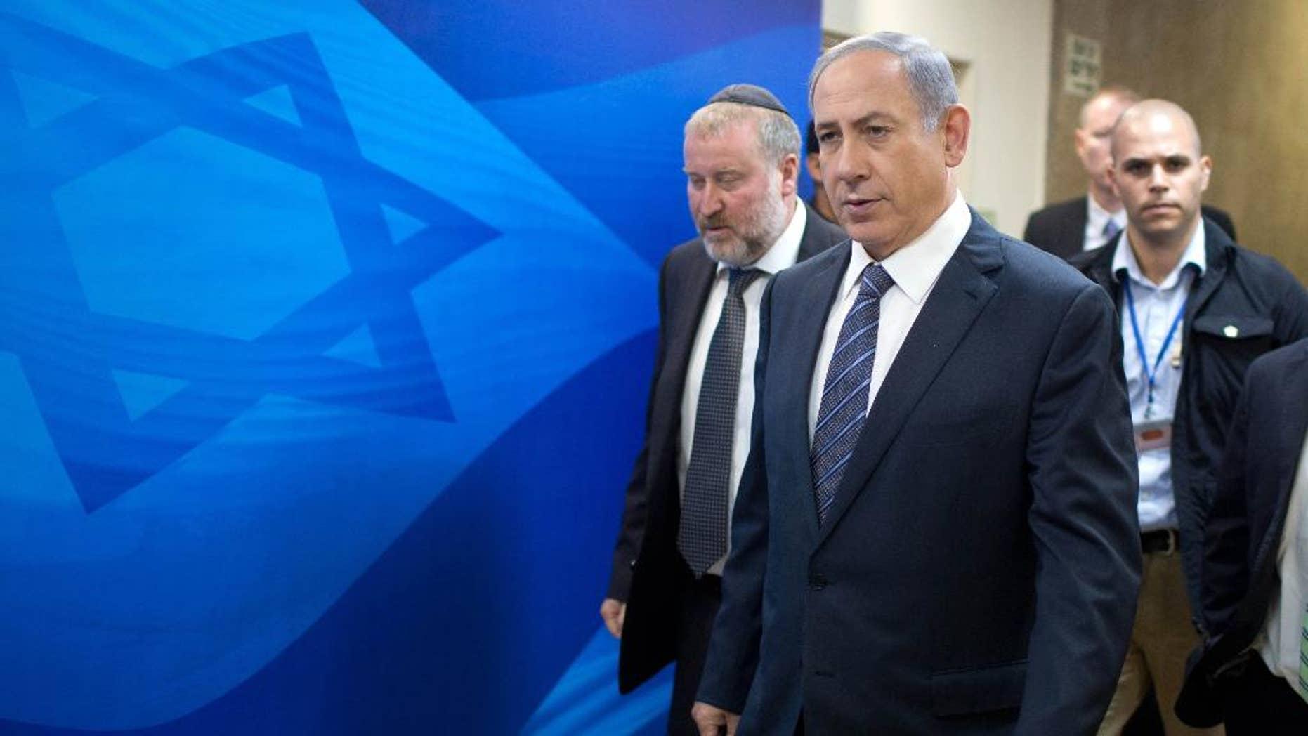 Israeli Prime Minister Benjamin Netanyahu, second left, and Cabinet Secretary, Avichai Mandelblit, left, arrive for the the weekly cabinet meeting at the prime minister's office in Jerusalem, Sunday, Sept. 6, 2015. (Menahem Kahana/Pool photo via AP)