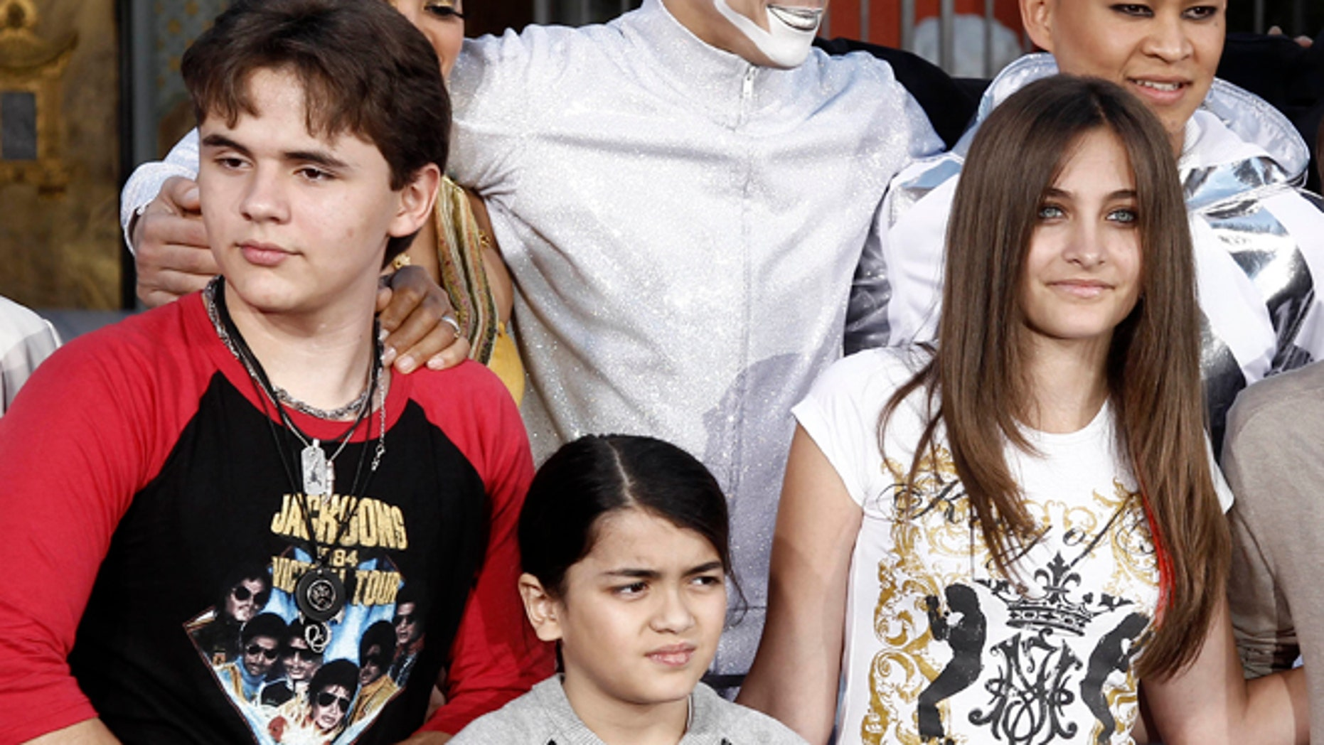 Jan. 26, 2012: This file photo shows, from left, Prince Jackson, Blanket Jackson and Paris Jackson after a hand and footprint ceremony honoring their father musician Michael Jackson in front of Grauman's Chinese Theatre in Los Angeles.