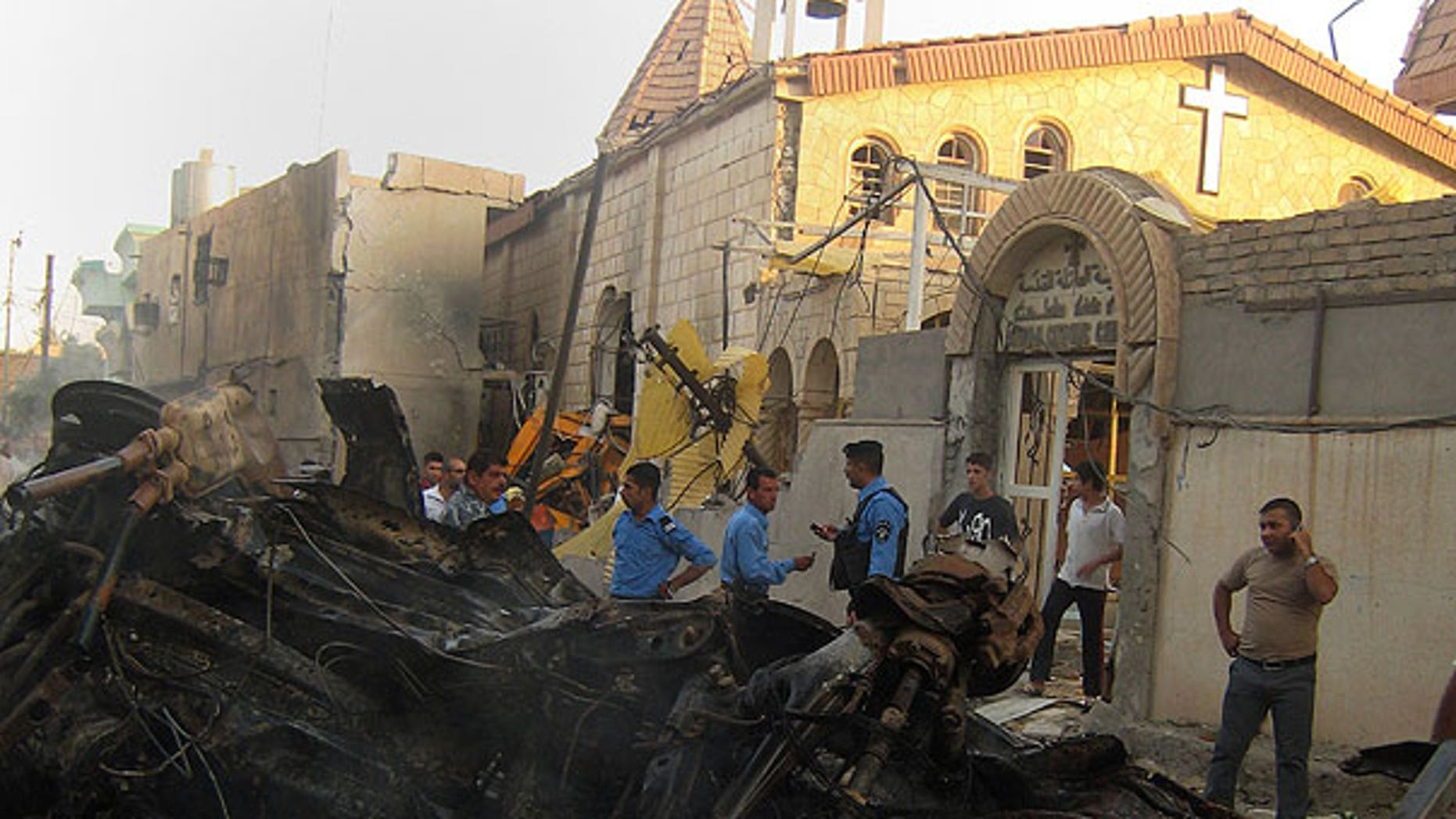 Aug. 2: Iraqis inspect the site of an early morning car bomb attack in front of a Church in Kirkuk, 180 miles north of Baghdad, Iraq.