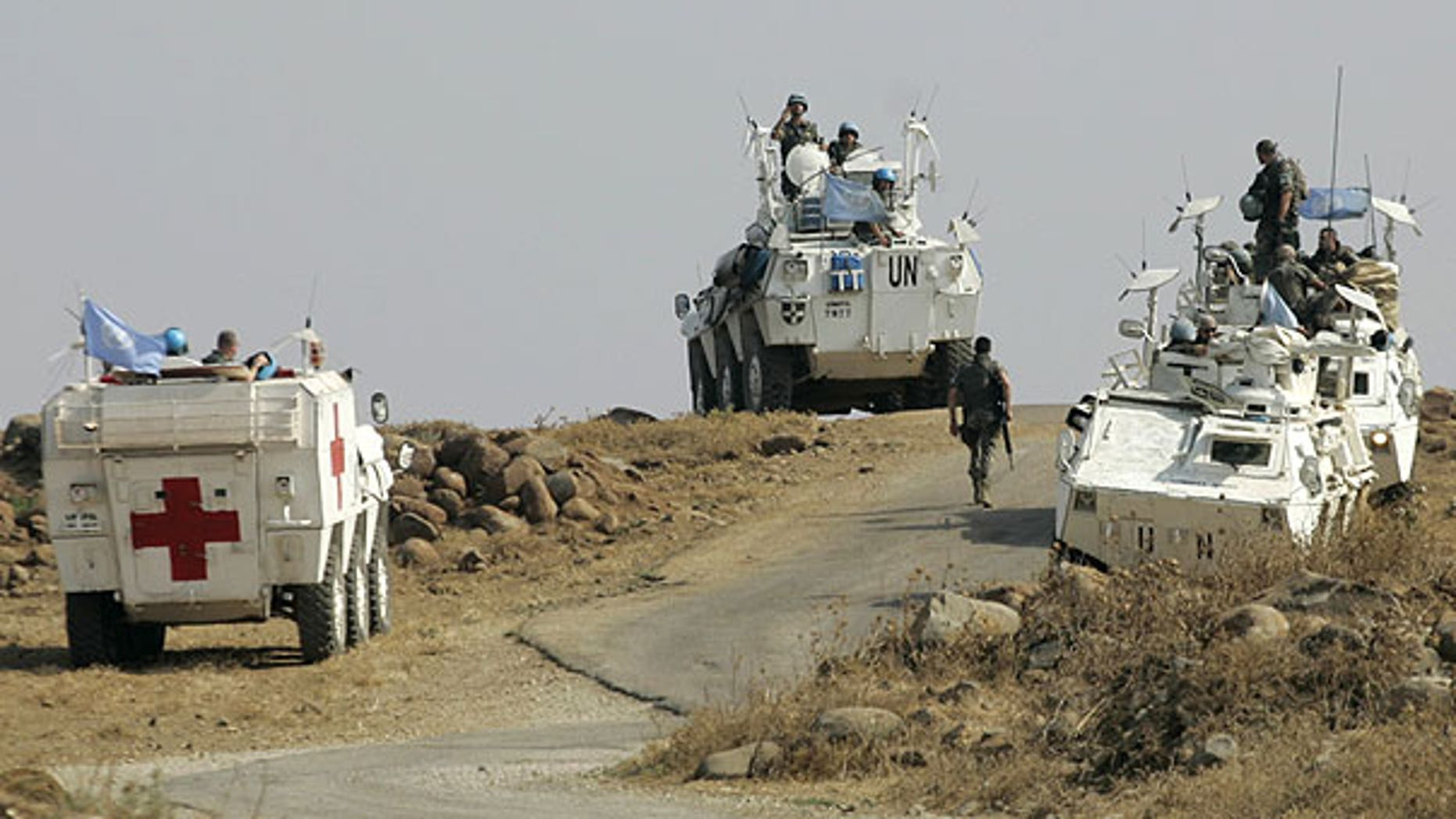 Aug. 1: Spanish United Nations peacekeepers atop armored vehicles patrol the border in the southeastern Wazzani River area, Lebanon.