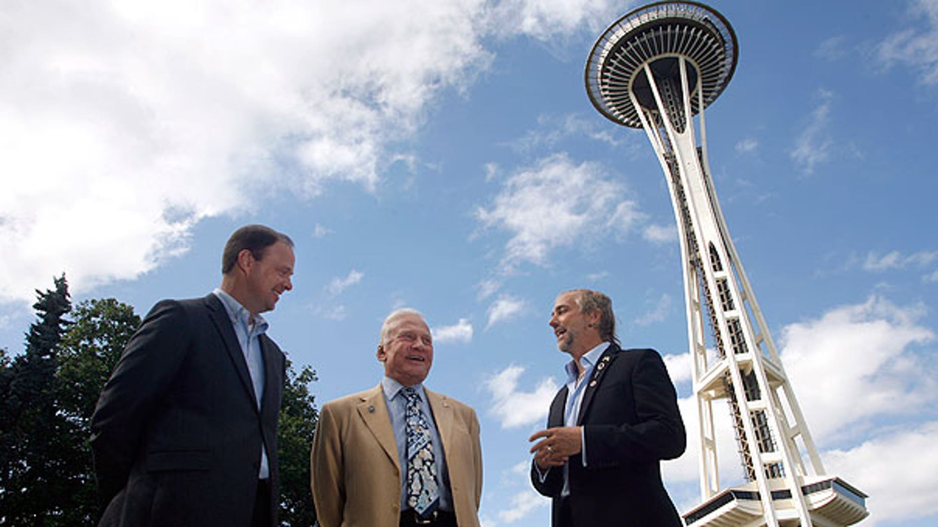 July 31: Buzz Aldrin, former astronaut (center), and Richard Garriott, first second-generation space traveler (right), talk about space exploration outside the Space Needle in Seattle as Ron Sevart, CEO of the Space Needle, listens in.