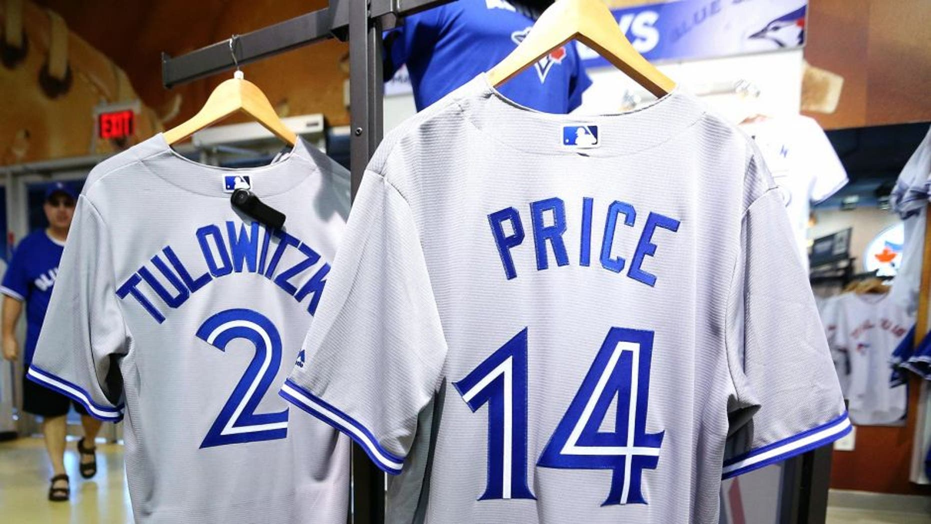 TORONTO, ON- JULY 30 - Not long after Toronto Blue Jays General Manager Alex Anthopoulos announces his trade with the Detroit Tigers for starting pitcher David Price workers in the Jays Shop started making number 14 David Price jerseys. The staff is still busy making Troy Tulowitzki number 2 jerseys in Toronto. July 30, 2015. (Steve Russell/Toronto Star via Getty Images)