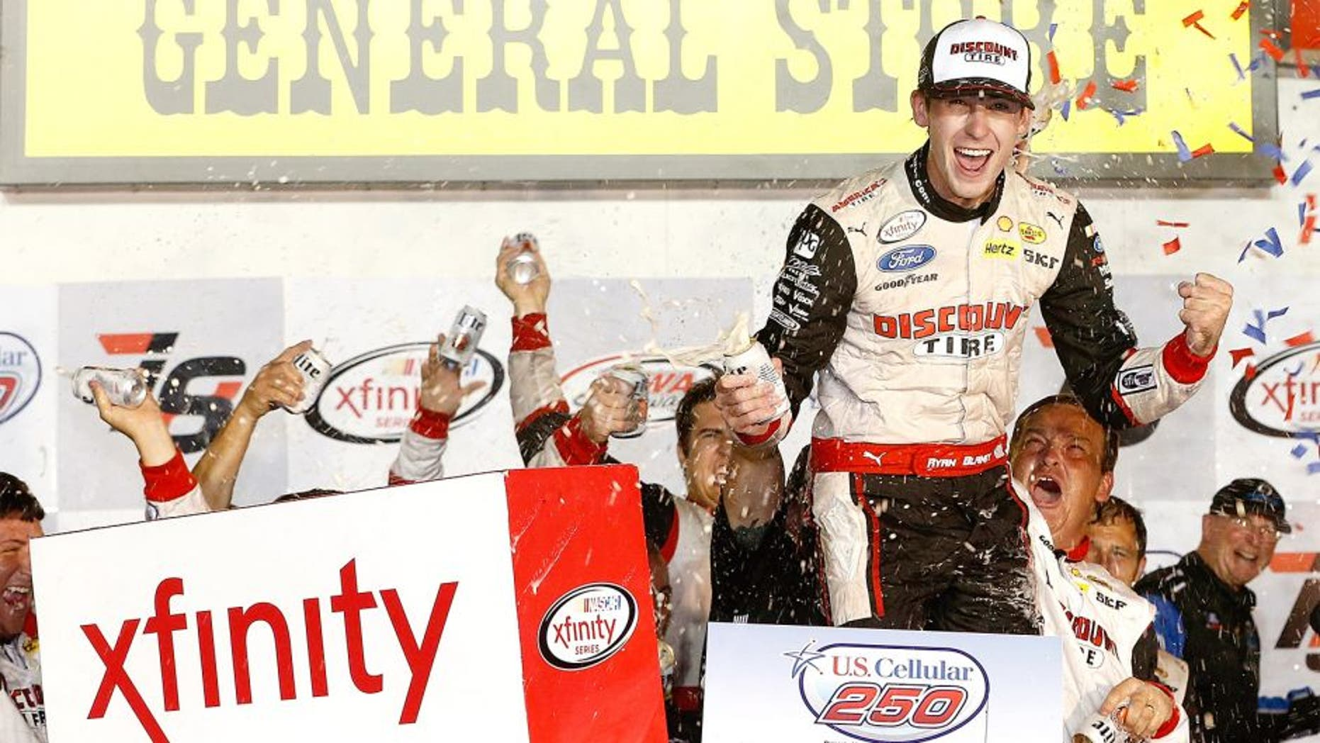 NEWTON, IA - AUGUST 01: Ryan Blaney, driver of the #22 Discount Tire Ford, celebrates in victory lane after winning the NASCAR XFINITY Series U.S. Cellular 250 at Iowa Speedway on August 1, 2015 in Newton, Iowa. (Photo by Brian Lawdermilk/NASCAR via Getty Images)