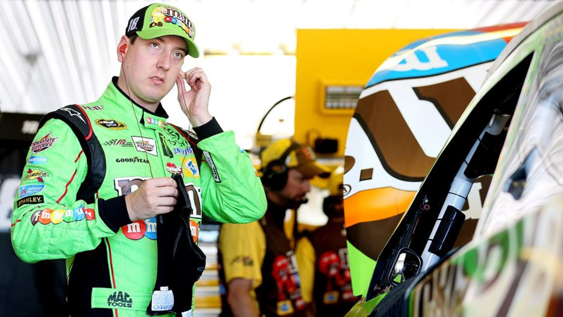 LONG POND, PA - JULY 31: Kyle Busch, driver of the #18 M&M's Crispy Toyota, stands in the garage during practice for the NASCAR Sprint Cup Series Windows 10 400 at Pocono Raceway on July 31, 2015 in Long Pond, Pennsylvania. (Photo by Nick Laham/Getty Images)