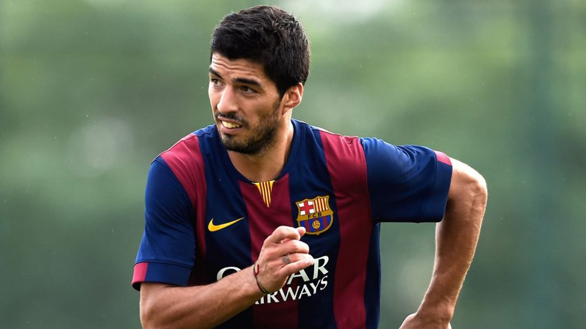 BARCELONA, SPAIN - SEPTEMBER 24: Luis Suarez of FC Barcelona looks on during a friendly match between FC Barcelona B and Indonesia U19 at Ciutat Esportiva on September 24, 2014 in Barcelona, Spain. (Photo by David Ramos/Getty Images)