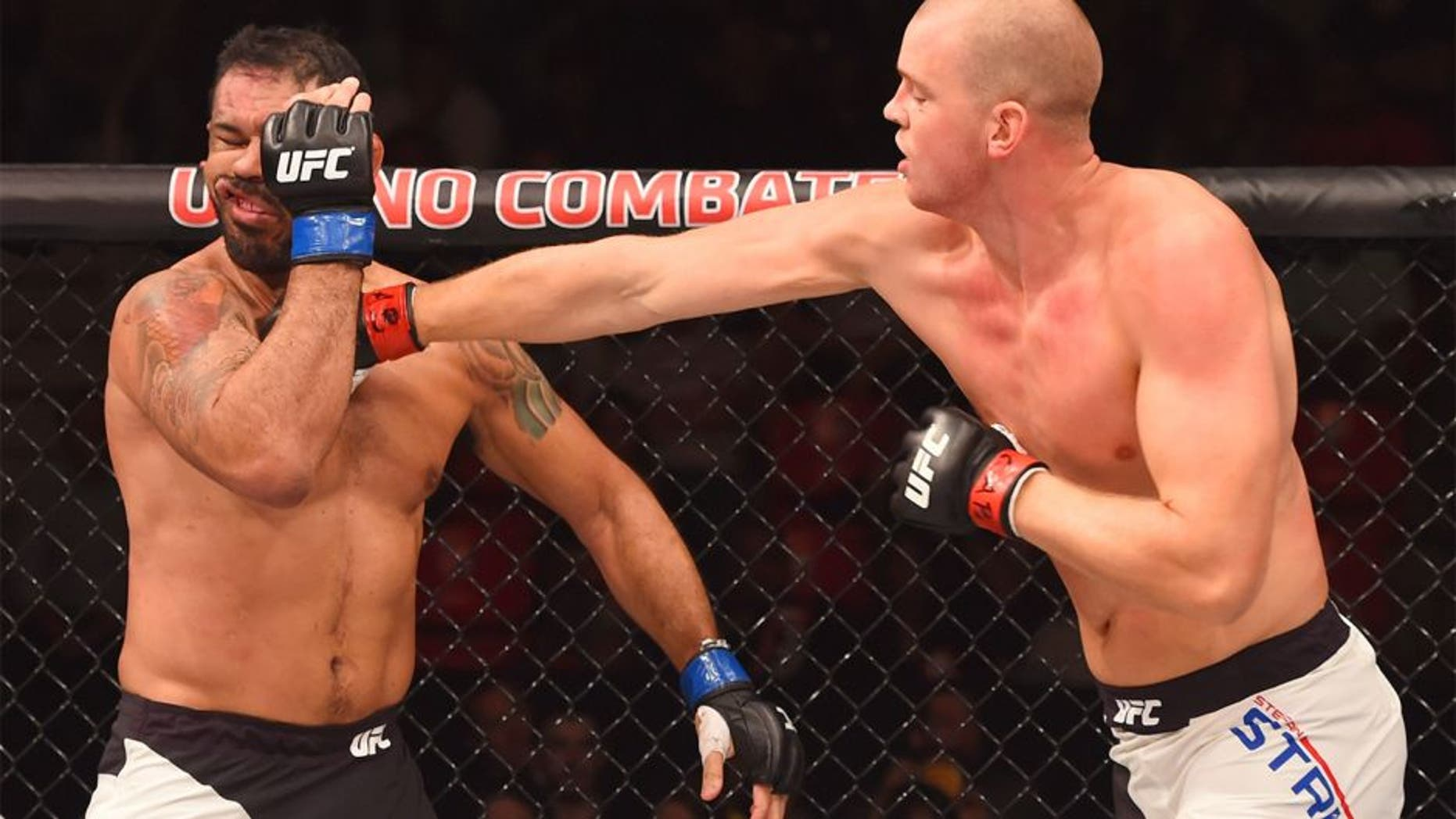 RIO DE JANEIRO, BRAZIL - AUGUST 01: (R-L) Stefan Struve of the Netherlands punches Rodrigo 'Minotauro' Nogueira of Brazil in their heavyweight bout during the UFC 190 event inside HSBC Arena on August 1, 2015 in Rio de Janeiro, Brazil. (Photo by Josh Hedges/Zuffa LLC/Zuffa LLC via Getty Images)