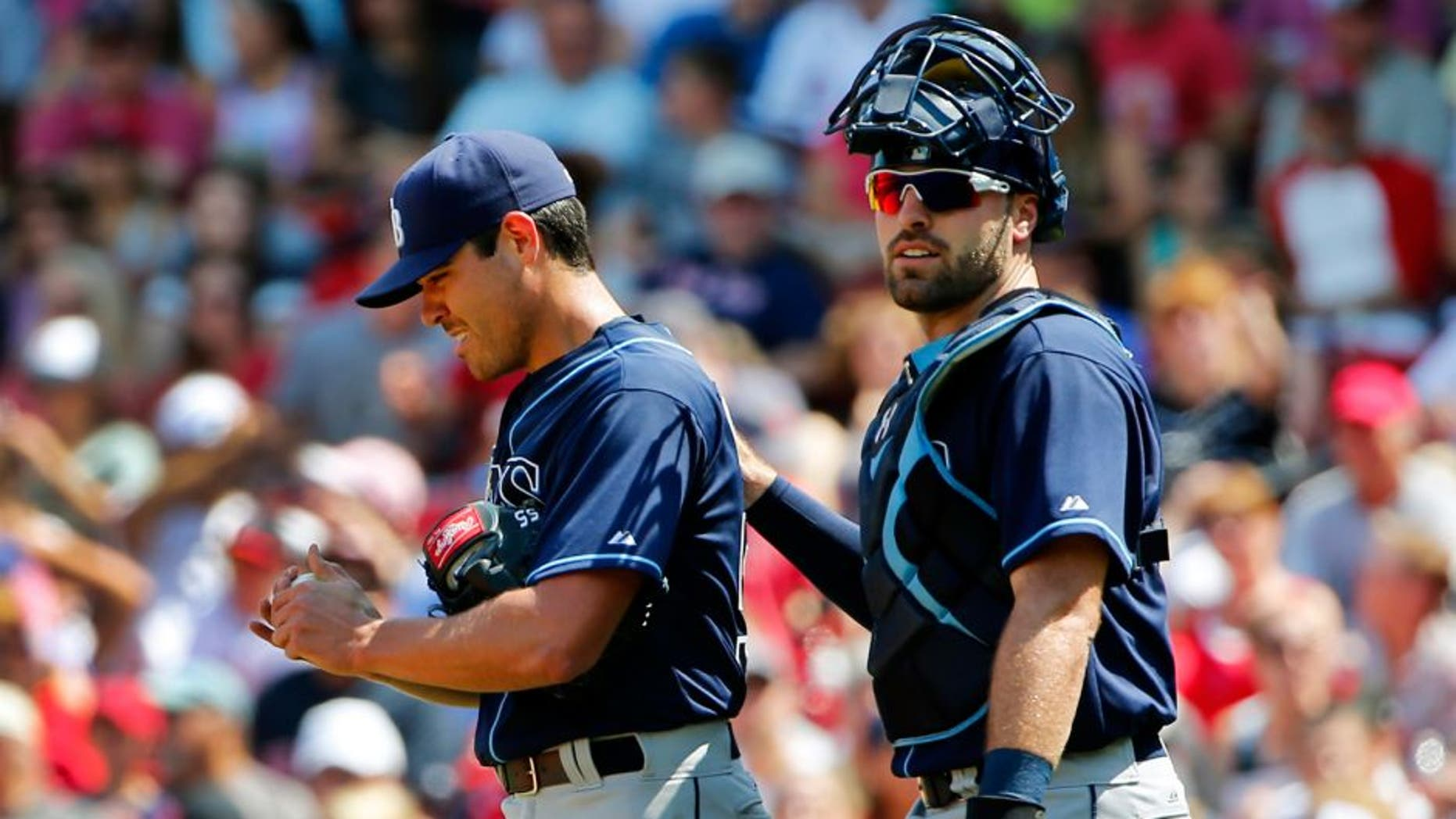 Tampa Bay Rays starting pitcher Matt Moore gets a pat on the back from catcher Curt Casali after giving up a run to the Boston Red Sox during the second inning of a baseball game at Fenway Park in Boston Saturday, Aug. 1, 2015. (AP Photo/Winslow Townson)