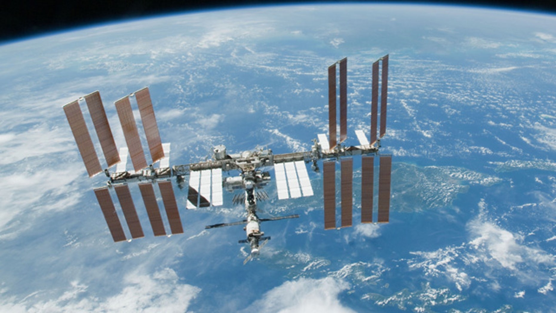 Feb. 19. 2010: This file photo provided by NASA shows the International Space Station with Earth's horizon as a backdrop.