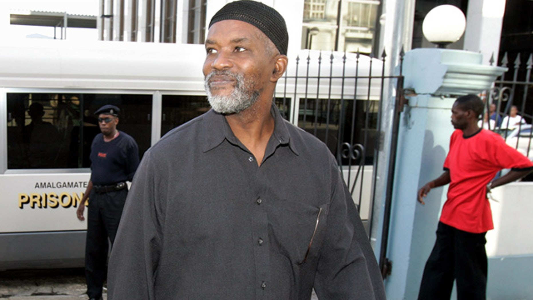 In this Aug. 6, 2007 photo, Guyanese Abdul Kadir, former member of the South American nation's Parliament, arrives at the Magistrates' Court for an extradition hearing in downtown Port-of-Spain, Trinidad.
