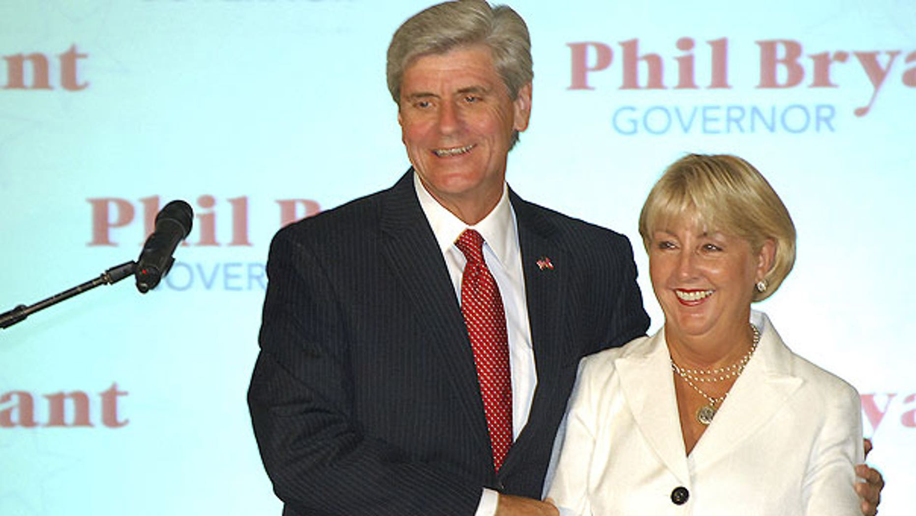 Aug. 2: Gubernatorial candidate Phil Bryant holds wife, Debra, as he greets supporters after being declared the winner of the Republican primary at the Old Capitol Inn in downtown Jackson, Miss.