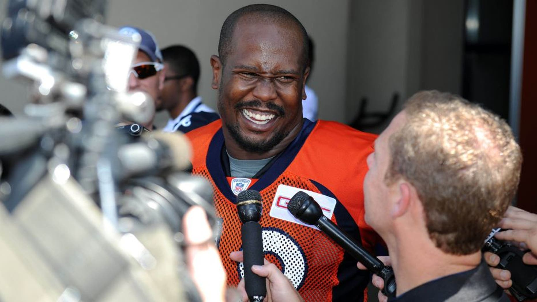 Jul 31, 2015; Englewood, CO, USA; Denver Broncos outside linebacker Von Miller (58) speaks to the media following training camp activities at the UCHealth Training Center. Mandatory Credit: Ron Chenoy-USA TODAY Sports