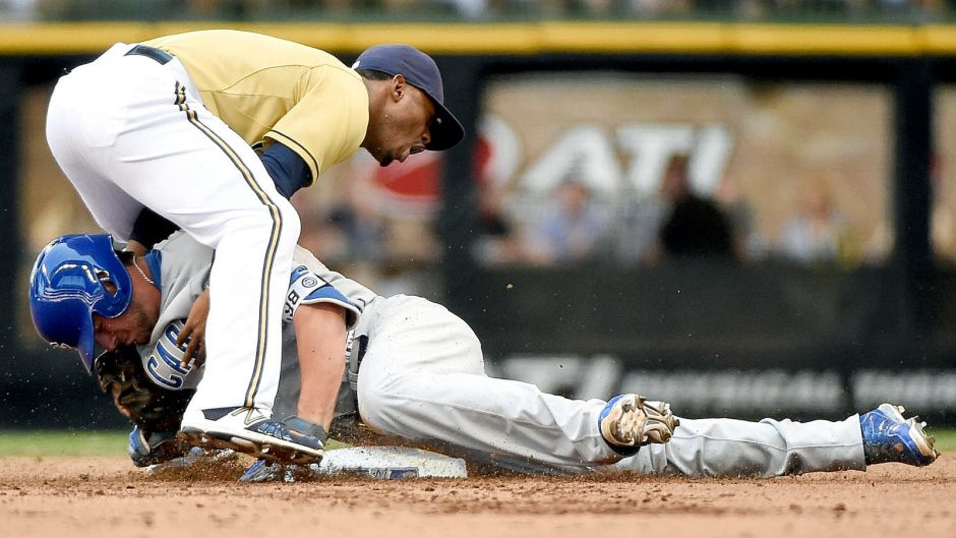 Aug 2, 2015; Milwaukee, WI, USA; Chicago Cubs third baseman Kris Bryant (17) slides safely into 2nd base before tag by Milwaukee Brewers shortstop Jean Segura (9) in the fifth inning at Miller Park. Bryant was injured on the play and had to leave the game. Mandatory Credit: Benny Sieu-USA TODAY Sports