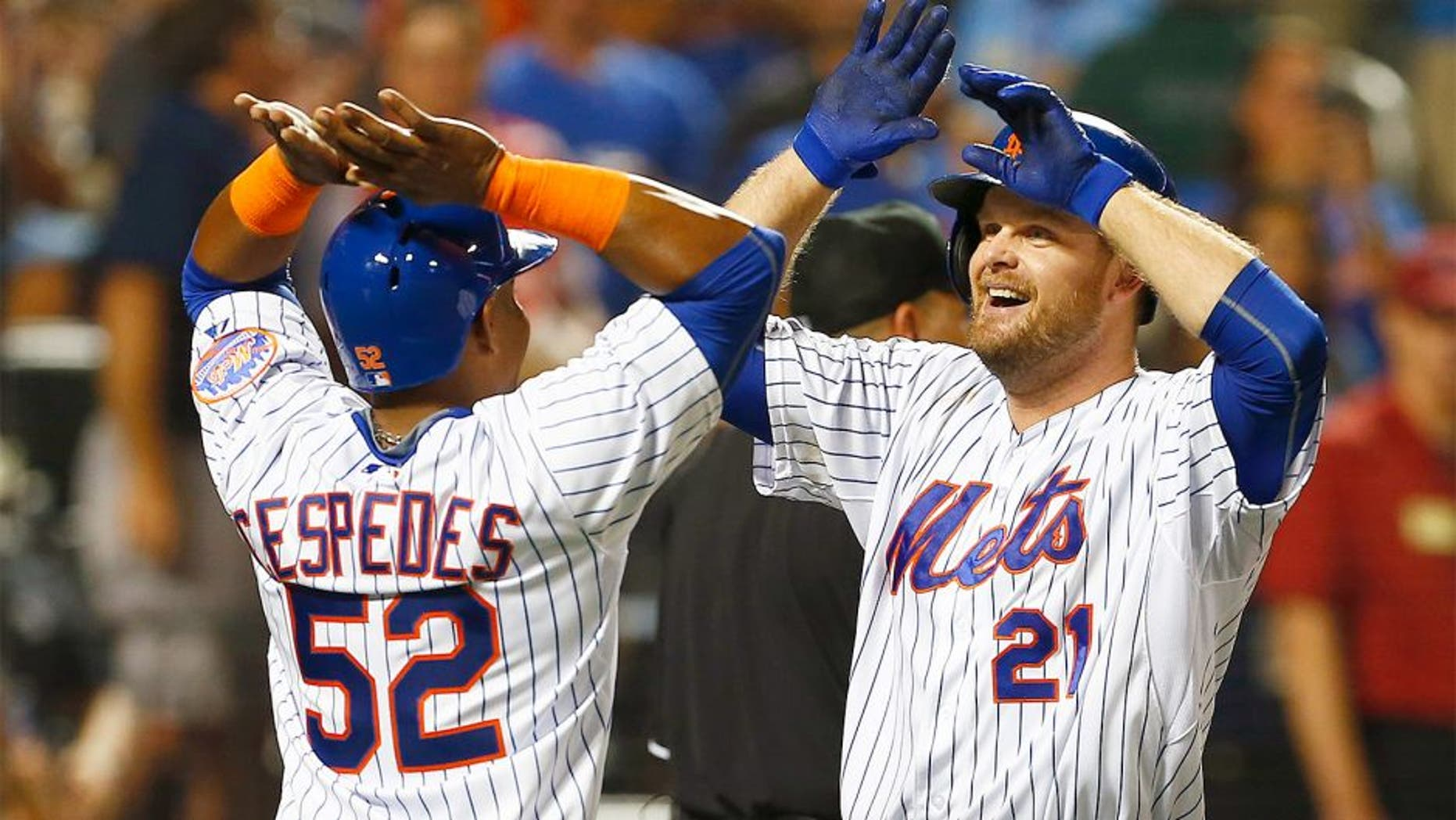 NEW YORK, NY - AUGUST 2: Lucas Duda #21 of the New York Mets is congratulated by Yoenis Cespedes #52 after both scored on Duda's two run home run during the third inning against the Washington Nationals on August 2, 2015 at Citi Field in the Flushing neighborhood of the Queens borough of New York City. (Photo by Rich Schultz/Getty Images)