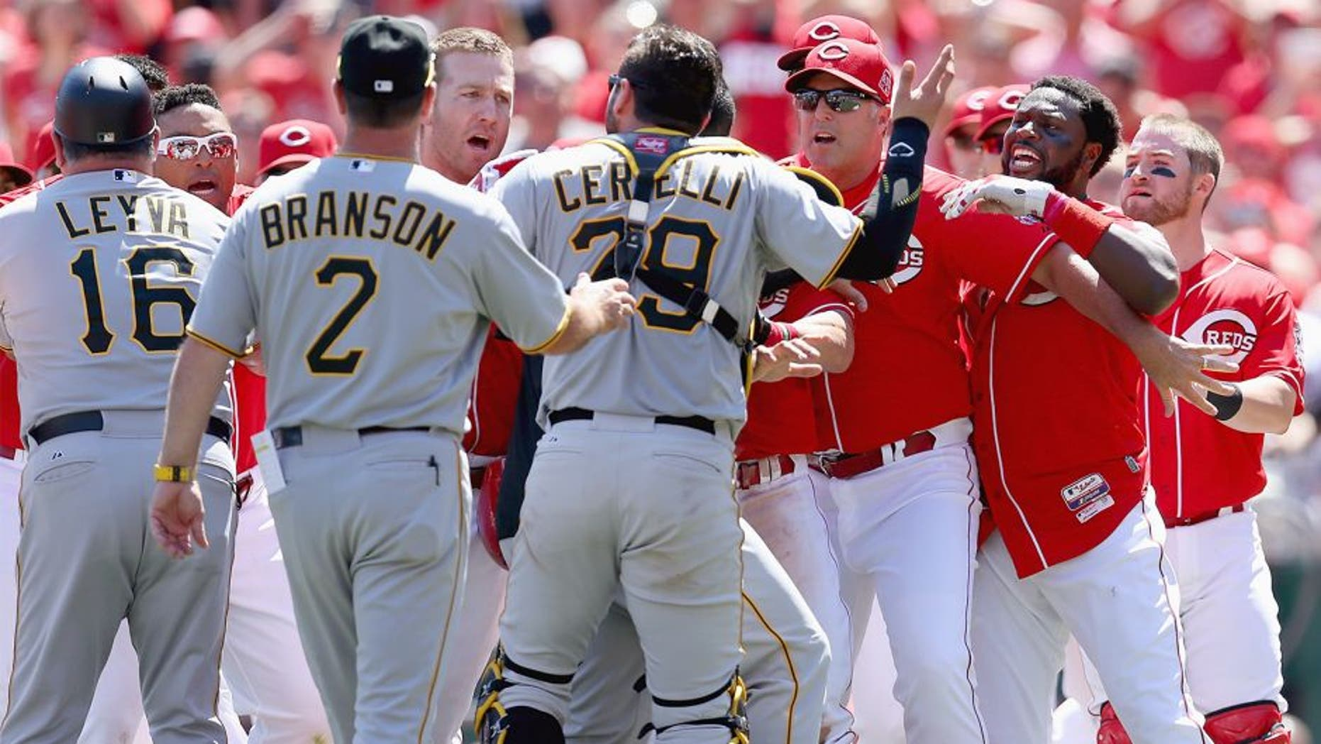 CINCINNATI, OH - AUGUST 02: Brandon Phillips #4 (far right) of the Cincinnati Reds is restrained by Manager Bryan Price after being hit by a pitch in the 8th inning against the Pittsburgh Pirates and benches emptied at Great American Ball Park on August 2, 2015 in Cincinnati, Ohio. (Photo by Andy Lyons/Getty Images)