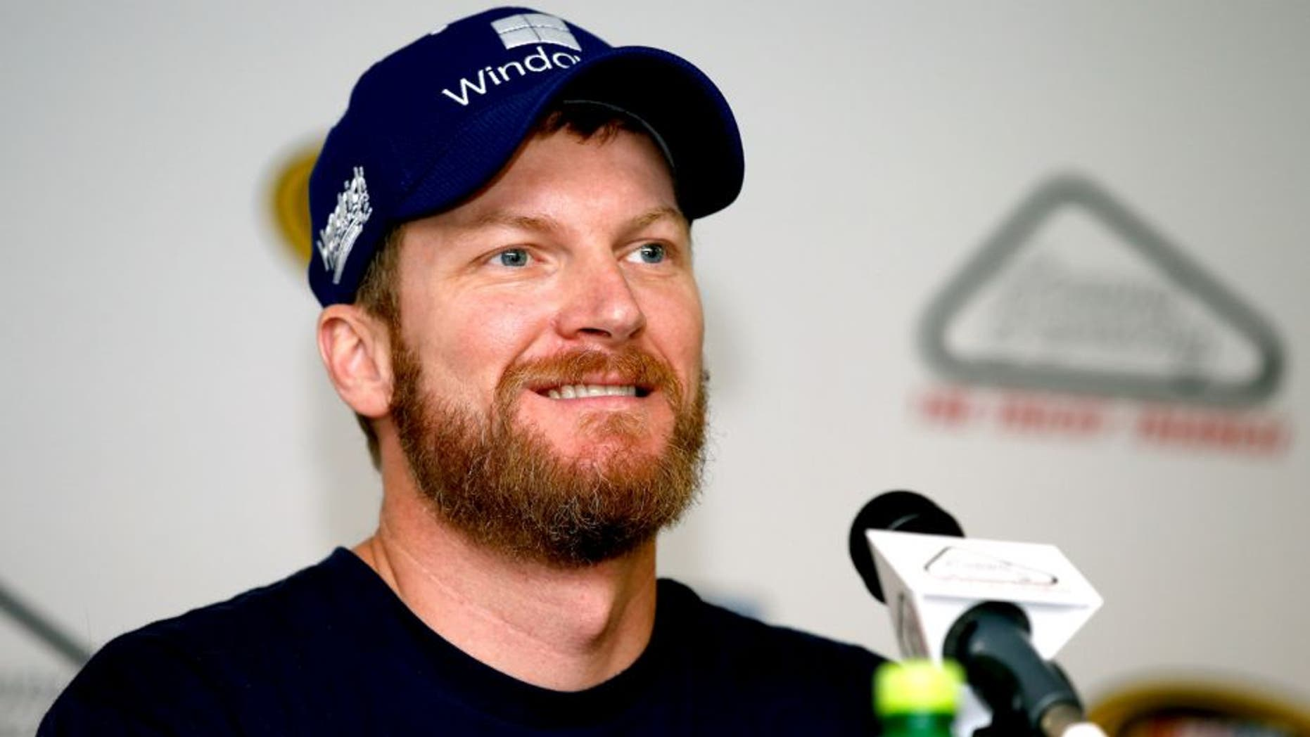 LONG POND, PA - JULY 31: Dale Earnhardt Jr., driver of the #88 Microsoft Chevrolet, speaks to the media following practice for the NASCAR Sprint Cup Series Windows 10 400 at Pocono Raceway on July 31, 2015 in Long Pond, Pennsylvania. (Photo by Todd Warshaw/NASCAR via Getty Images)