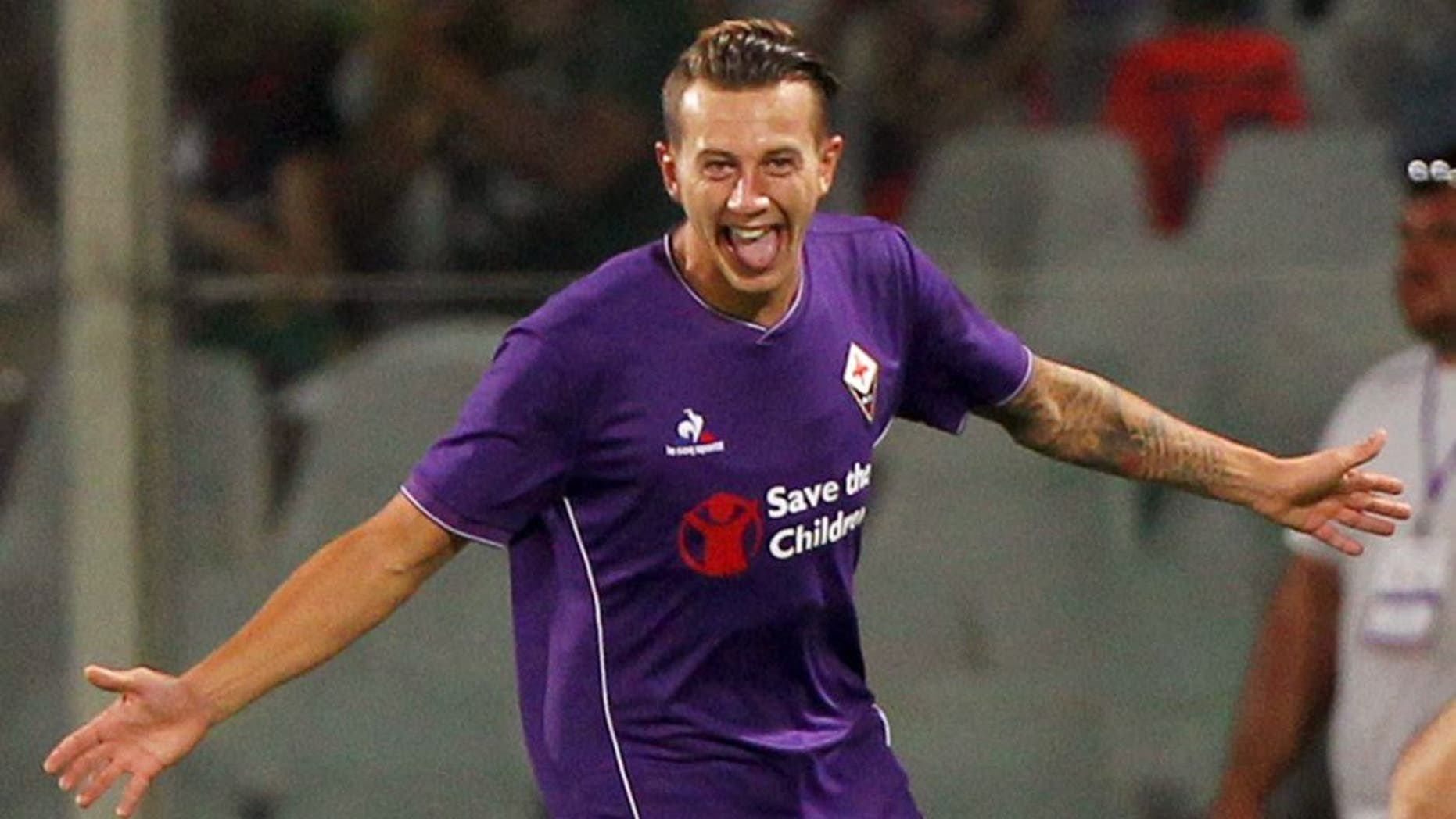 FLORENCE, ITALY - AUGUST 02: Federico Bernardeschi of ACF Fiorentina celebrates after scoring the opening goal during the preseason friendly match between ACF Fiorentina and FC Barcelona at Artemio Franchi on August 2, 2015 in Florence, Italy. (Photo by Paolo Bruno/Getty Images)