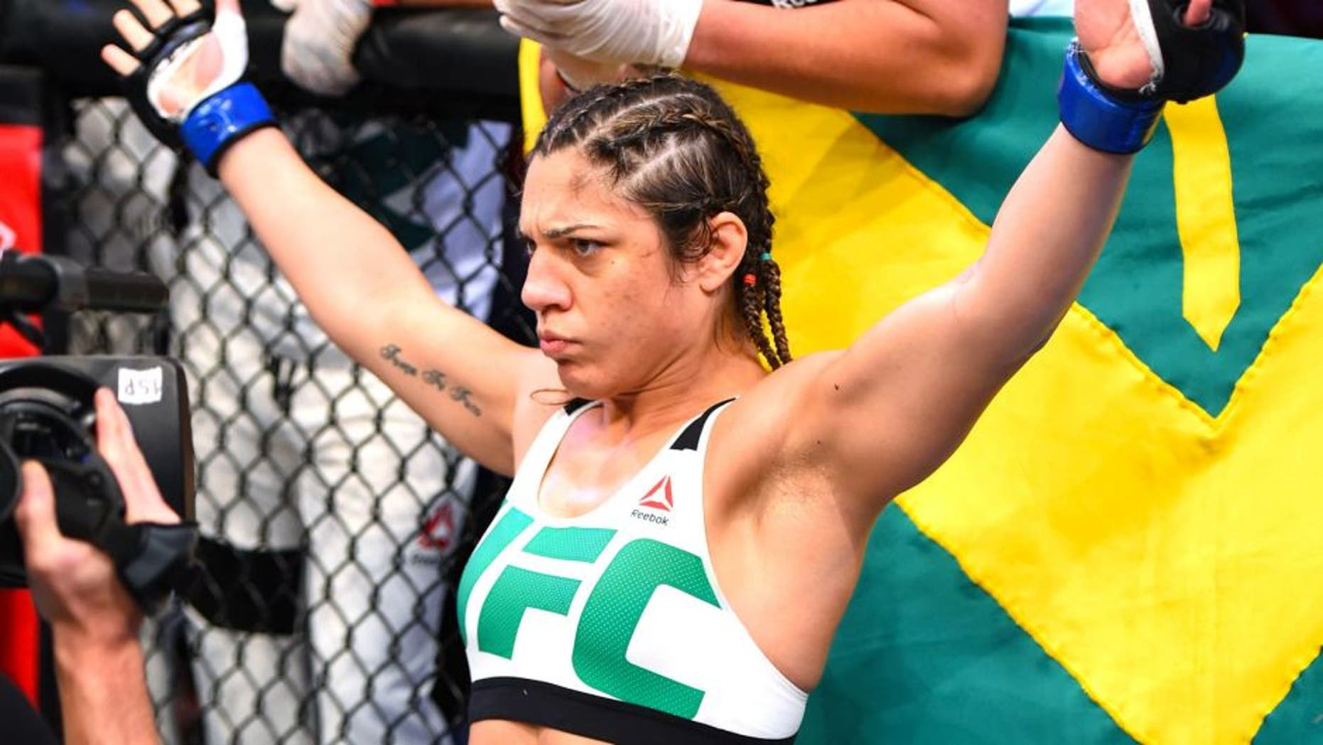 RIO DE JANEIRO, BRAZIL - AUGUST 01: Bethe Correia of Brazil enters the Octagon before facing Ronda Rousey of the United States in their UFC women's bantamweight championship bout during the UFC 190 event inside HSBC Arena on August 1, 2015 in Rio de Janeiro, Brazil. (Photo by Josh Hedges/Zuffa LLC/Zuffa LLC via Getty Images)