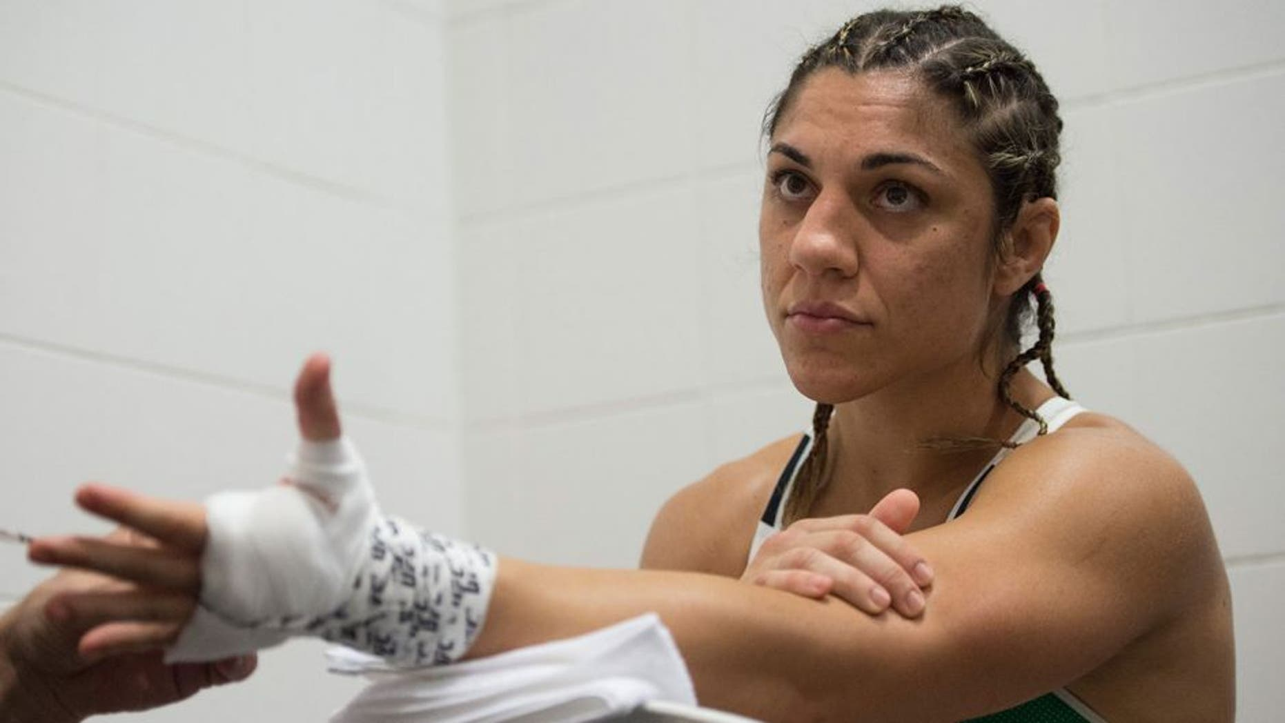 RIO DE JANEIRO, BRAZIL - AUGUST 01: Bethe Correia of Brazil gets her hands wrapped backstage during the UFC 190 event inside HSBC Arena on August 1, 2015 in Rio de Janeiro, Brazil. (Photo by Jeff Bottari/Zuffa LLC/Zuffa LLC via Getty Images)