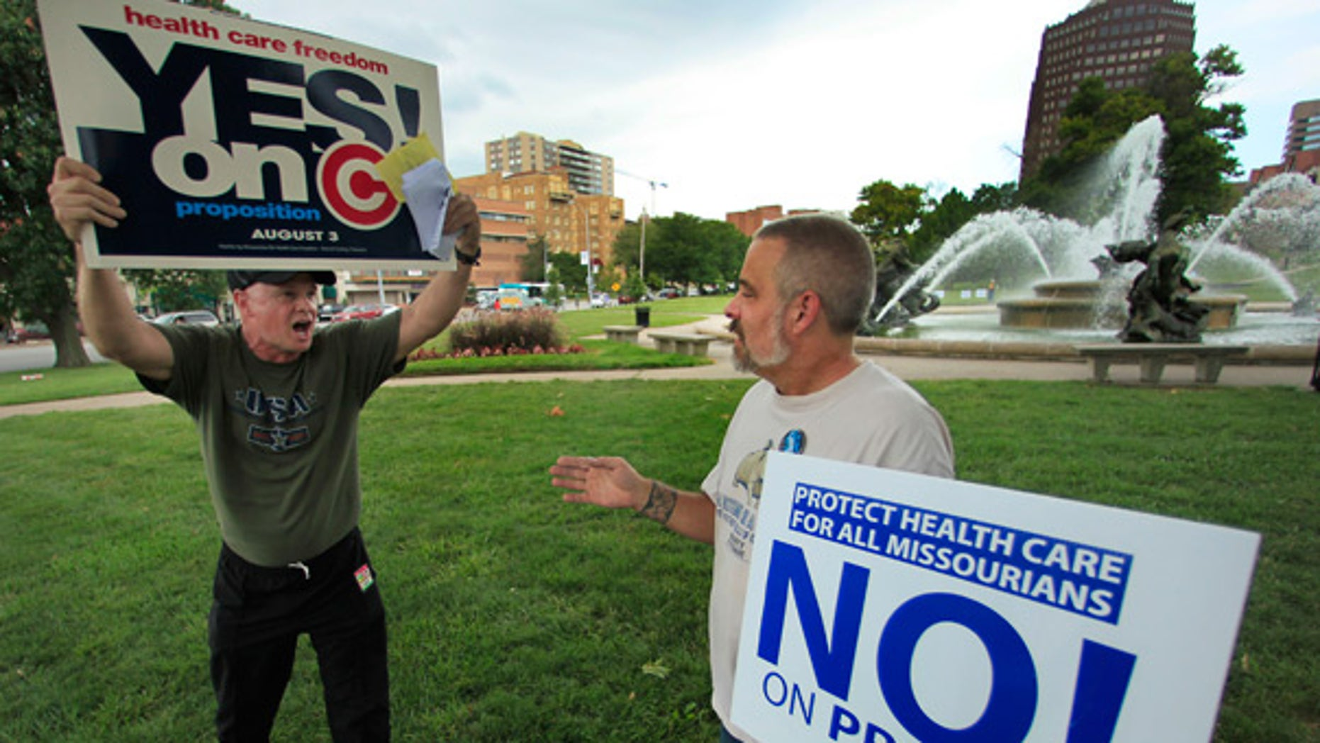 July 29: Proposition C supporter and opponent debate during a rally in Kansas City, Mo.
