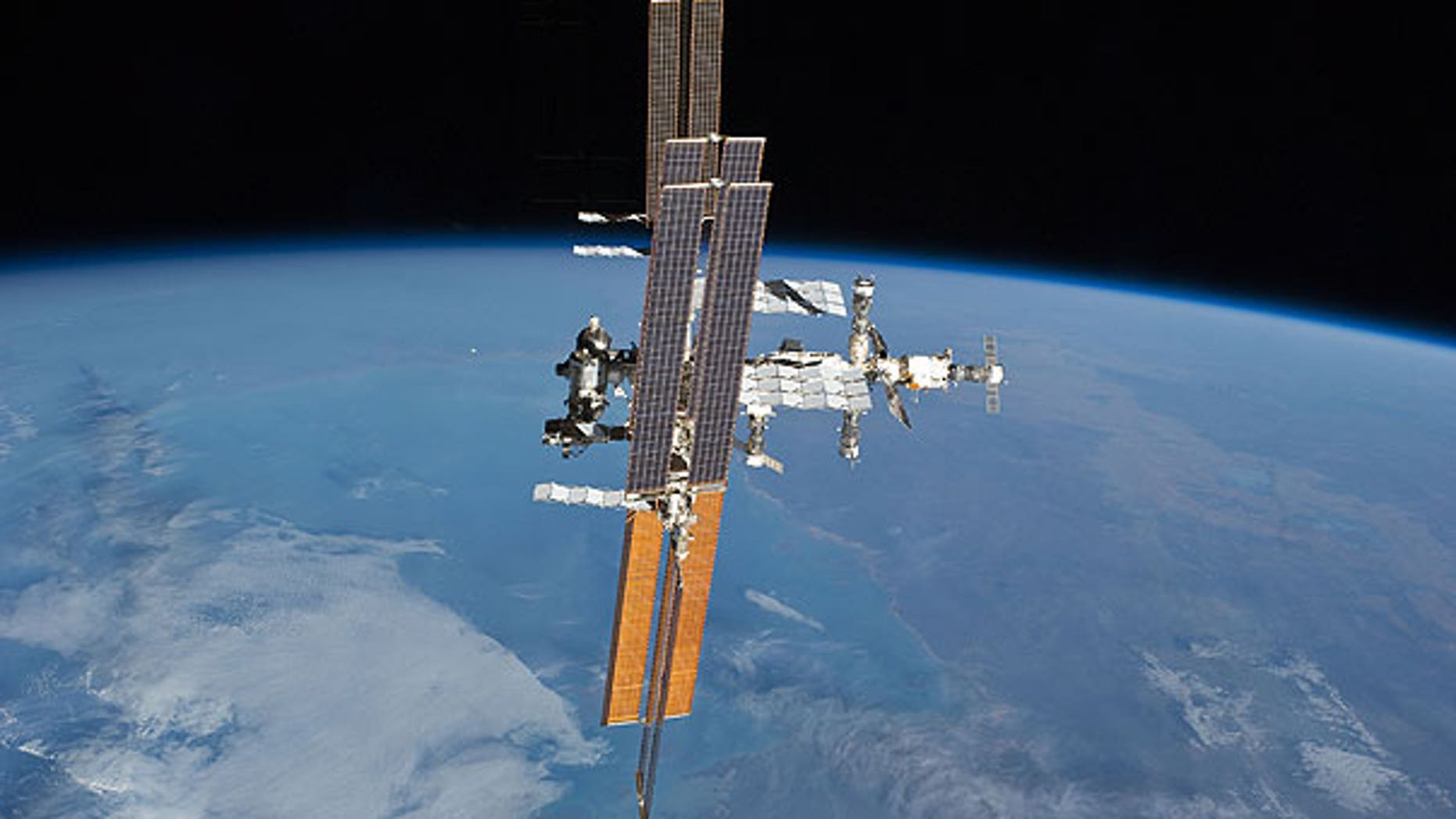 July 19: The International Space Station, photographed from the space shuttle Atlantis as the orbiting complex and the shuttle performed their relative separation.