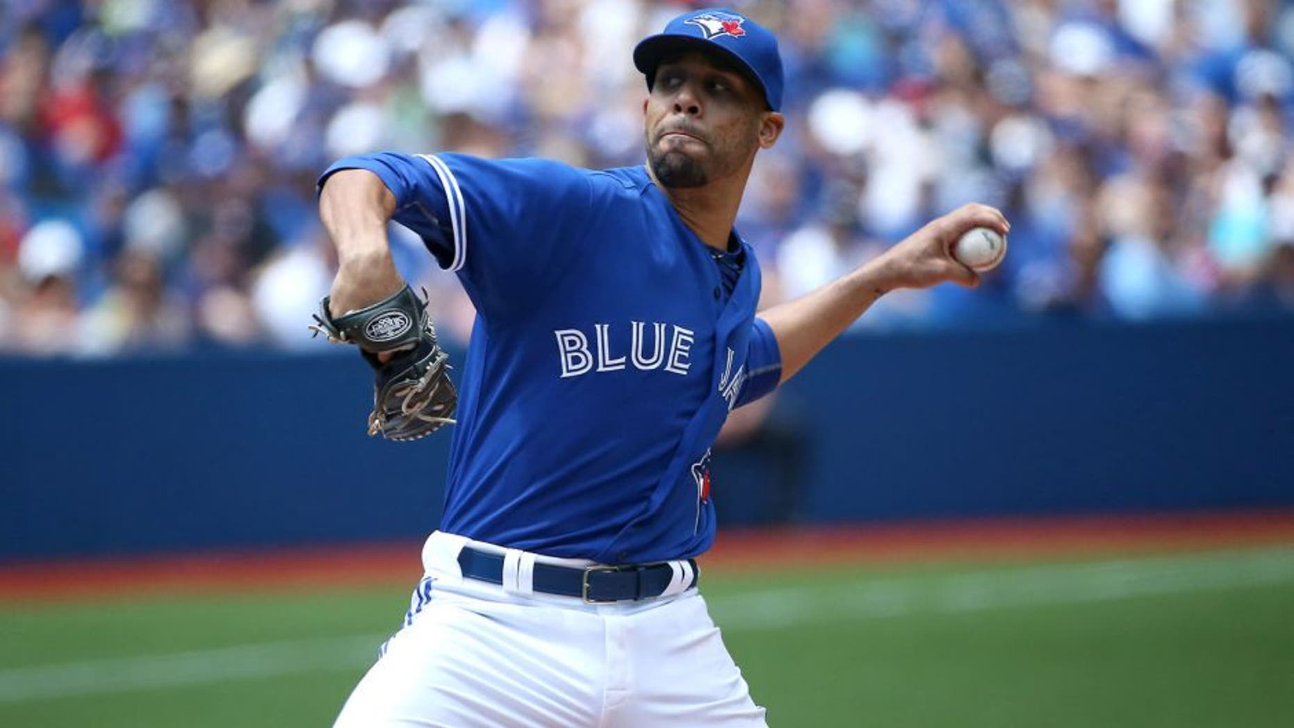 TORONTO, CANADA - AUGUST 3: David Price #14 of the Toronto Blue Jays delivers a pitch in the second inning during MLB game action against the Minnesota Twins on August 3, 2015 at Rogers Centre in Toronto, Ontario, Canada. (Photo by Tom Szczerbowski/Getty Images)