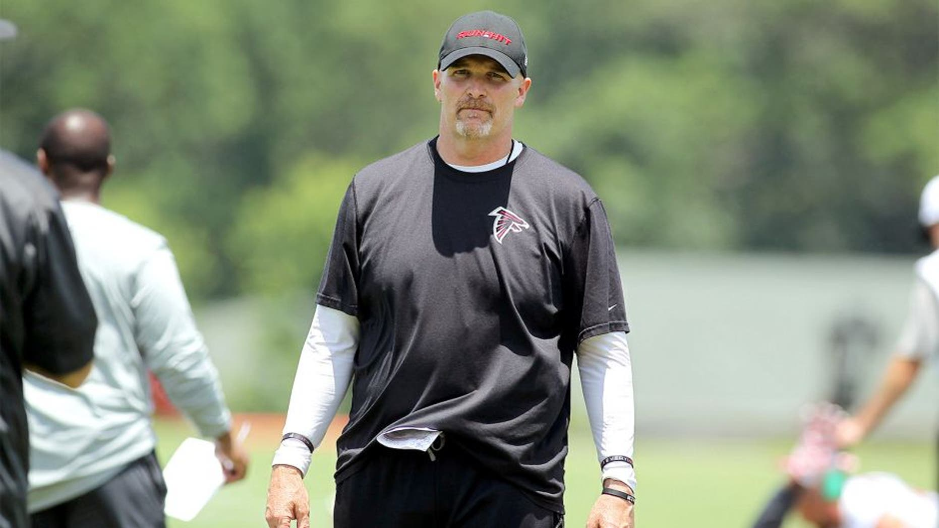 Jun 17, 2015; Atlanta, GA, USA; Atlanta Falcons head coach Dan Quinn coaches during minicamp at Falcons Training Facility. Mandatory Credit: Brett Davis-USA TODAY Sports