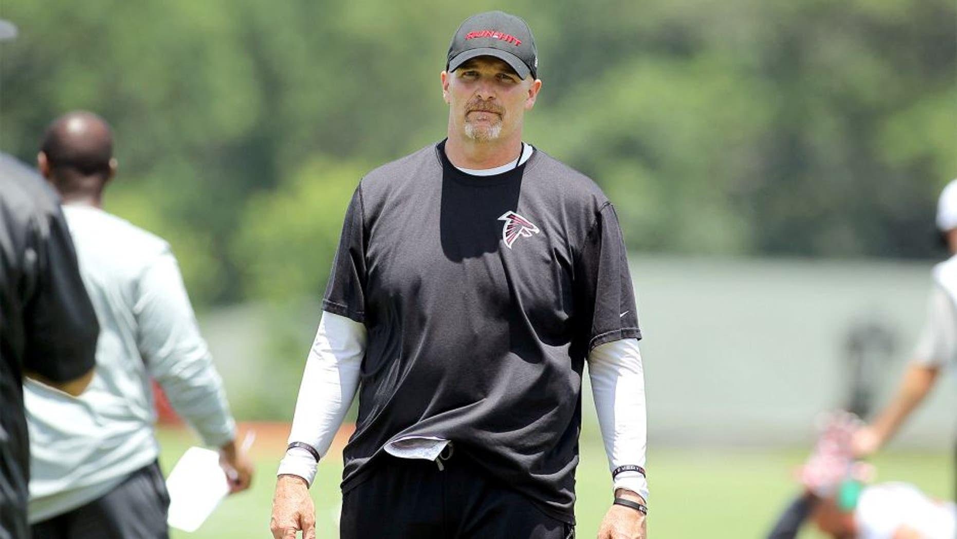 Jun 17, 2015; Atlanta, GA, USA; Atlanta Falcons head coach Dan Quinn coaches during minicamp at Falcons Training Facility. Mandatory Credit: Brett Davis-USA TODAY Sports