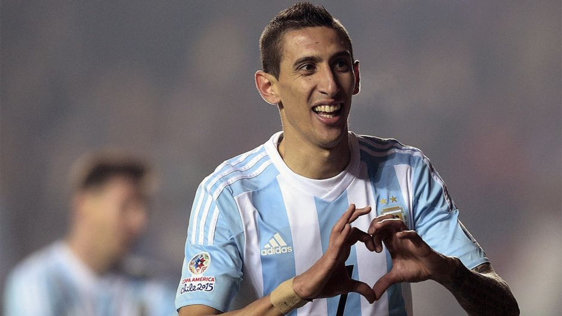 Argentina's forward Angel Di Maria celebrates after scoring against Paraguay during their Copa America semifinal football match in Concepcion, Chile on June 30, 2015. AFP PHOTO / JUAN MABROMATA (Photo credit should read JUAN MABROMATA/AFP/Getty Images)