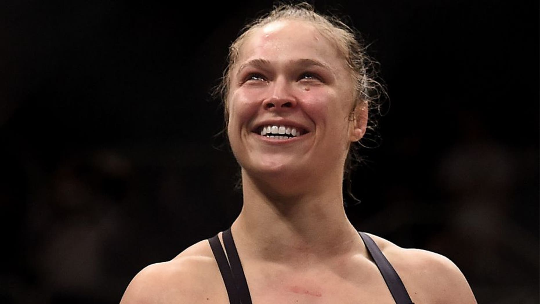 RIO DE JANEIRO, BRAZIL - AUGUST 01: Ronda Rousey of the United States celebrates victory over Bethe Correia of Brazil in their bantamweight title fight during the UFC 190 Rousey v Correia at HSBC Arena on August 1, 2015 in Rio de Janeiro, Brazil. (Photo by Buda Mendes/Zuffa LLC/Zuffa LLC via Getty Images)
