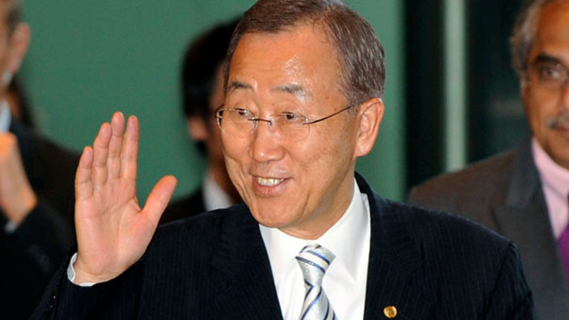 Aug. 4: U.N. Secretary-General Ban Ki-moon waves to reporters in Tokyo. A former American prosecutor has accused Ban of hiring discrimination based on gender and nationality.