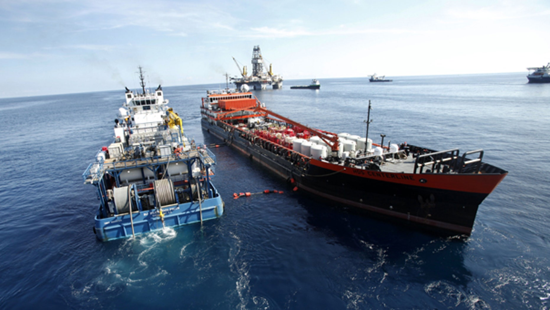 Aug 3: Ships are seen delivering the mud through hoses at the site of the Deepwater Horizon Oil Spill in Gulf of Mexico.