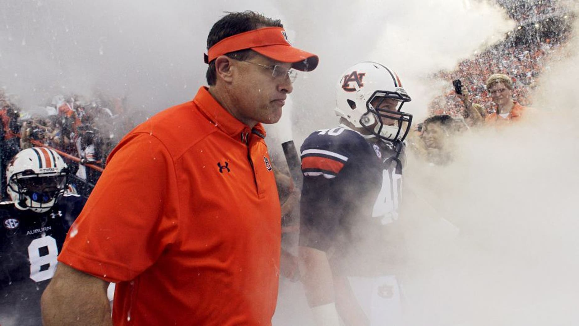 Aug 31, 2013; Auburn, AL, USA; Auburn Tigers head coach Gus Malzahn and his team enter the field at Jordan Hare Stadium for the game against the Washington State Cougars. The Tigers beat the Cougars 31-24. Mandatory Credit: John Reed-USA TODAY Sports