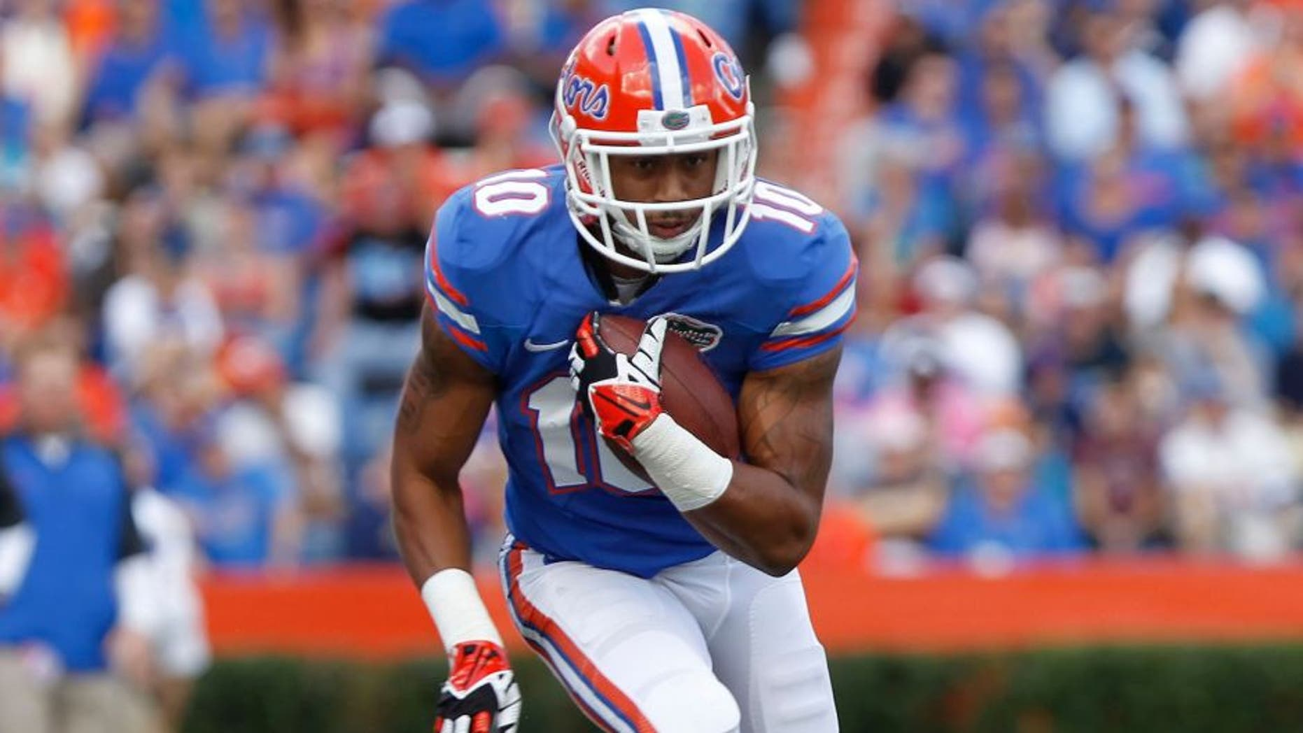 Nov 23, 2013; Gainesville, FL, USA; Florida Gators running back Valdez Showers (10) runs with the ball against the Georgia Southern Eagles during the first quarter at Ben Hill Griffin Stadium. Mandatory Credit: Kim Klement-USA TODAY Sports