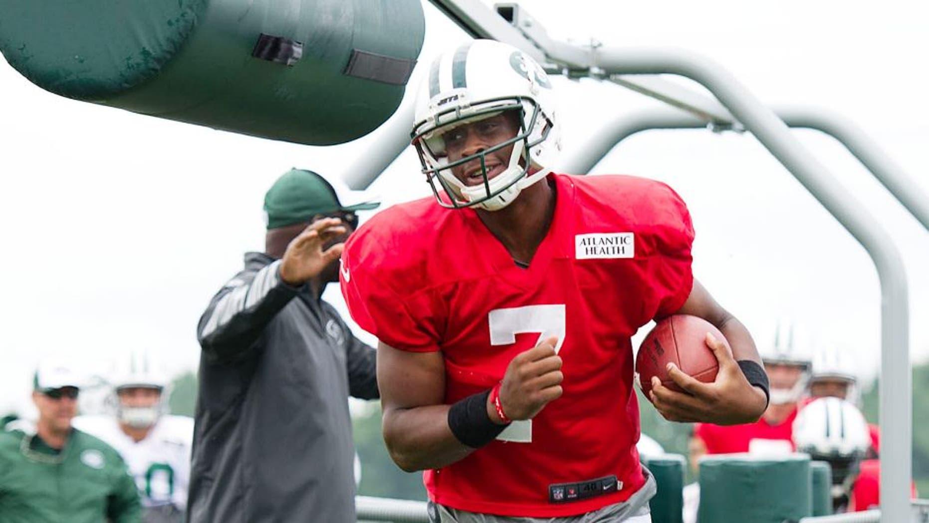 Aug 4, 2014; Cortland, NY, USA; New York Jets quarterback Geno Smith (7) runs with the ball during drills at training camp at SUNY Cortland. Mandatory Credit: Rich Barnes-USA TODAY Sports